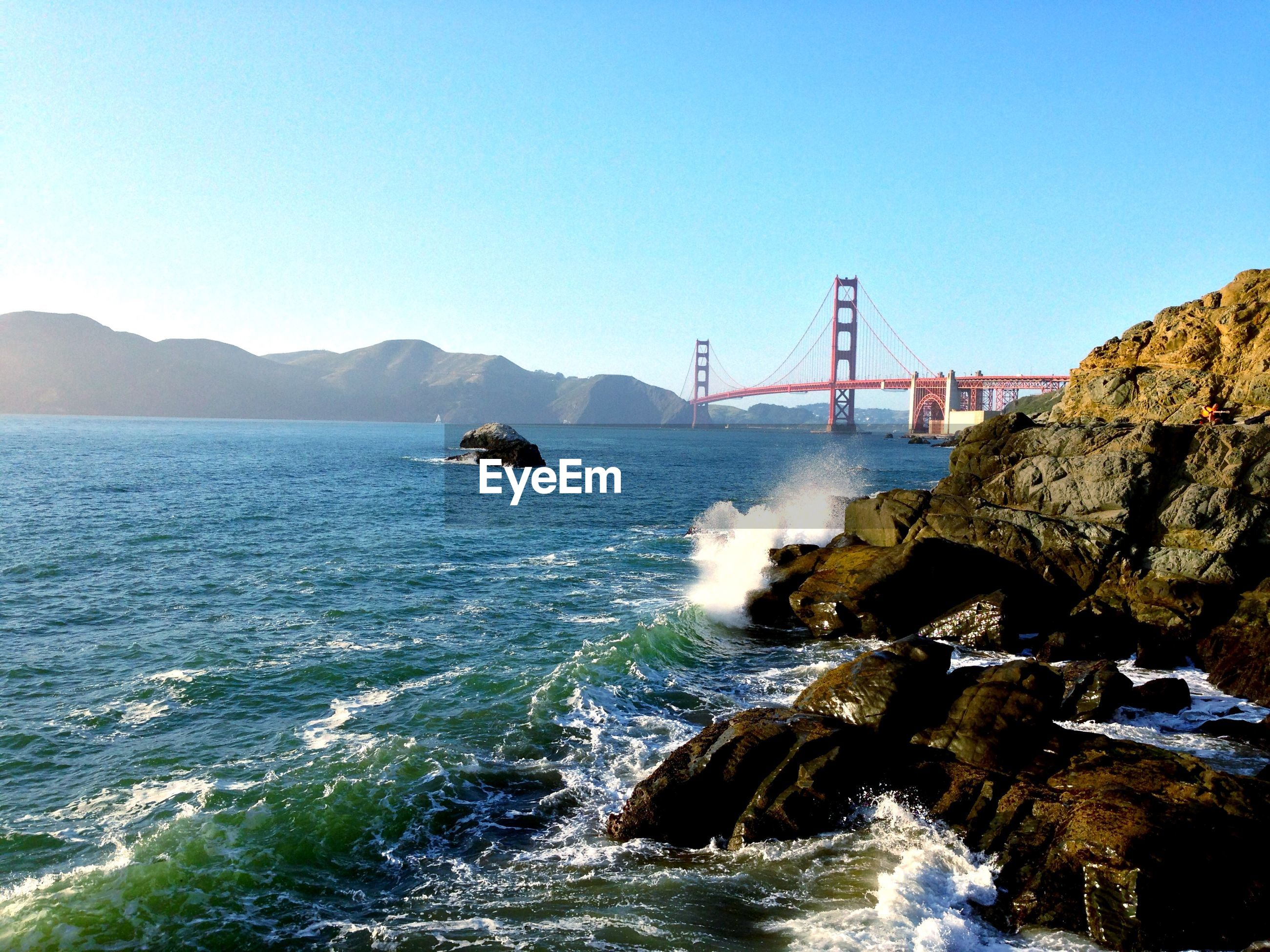 Scenic view of bay and golden gate bridge against sky