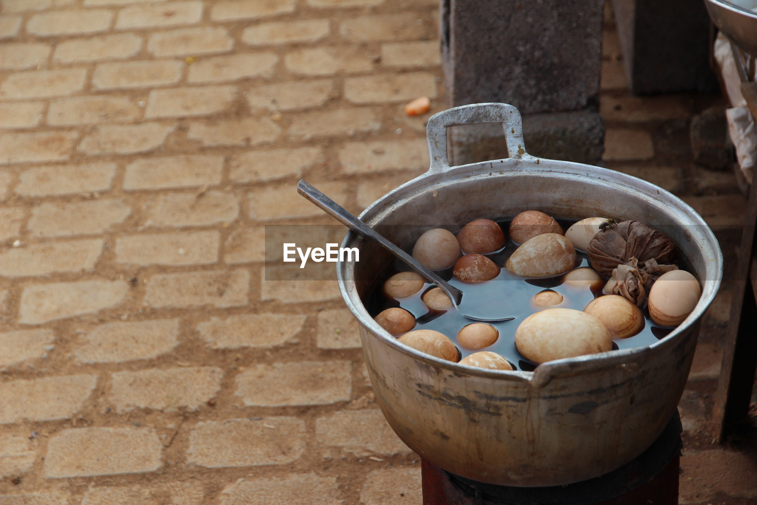 Close-up of boiled eggs in cooking pot for sale on street