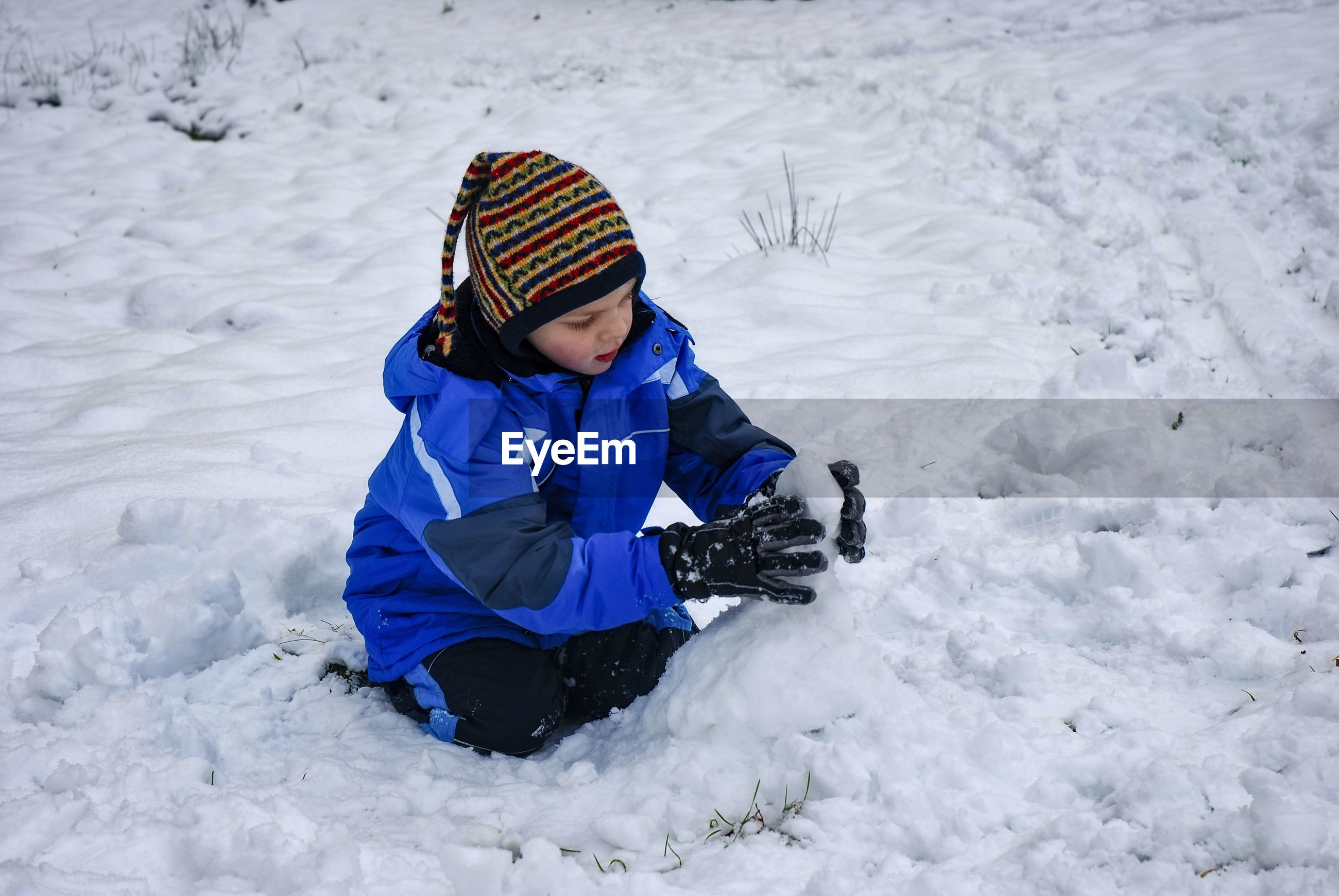 Boy on snow covered field