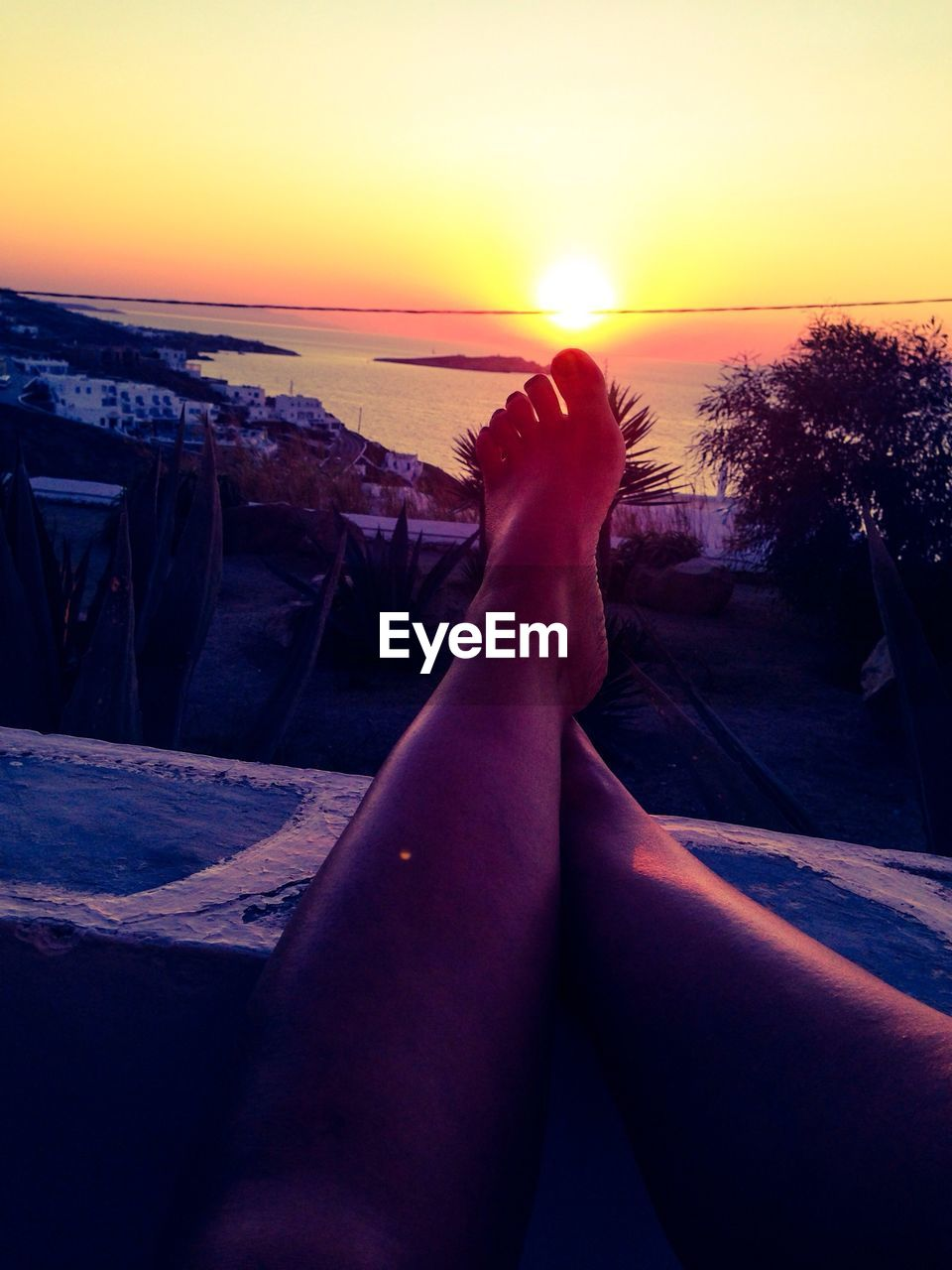 sunset, human leg, barefoot, low section, human foot, personal perspective, human body part, real people, sea, one person, sky, leisure activity, water, outdoors, scenics, sunlight, beauty in nature, women, vacations, nature, relaxation, lifestyles, horizon over water, clear sky, close-up, day, people