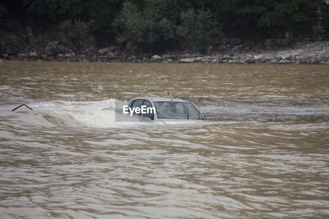 Car Submerged In Flood
