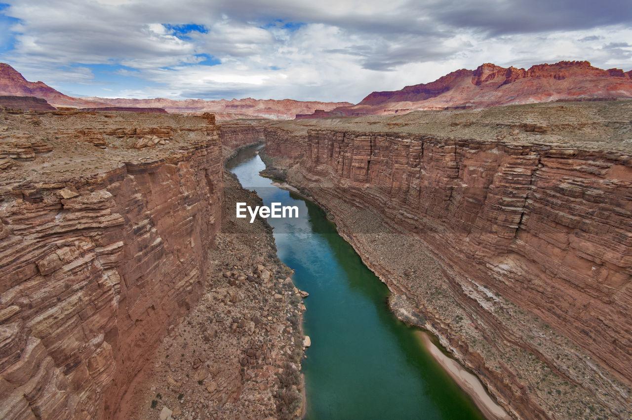 Colorado River Amidst Rock Formation At Grand Canyon National Park