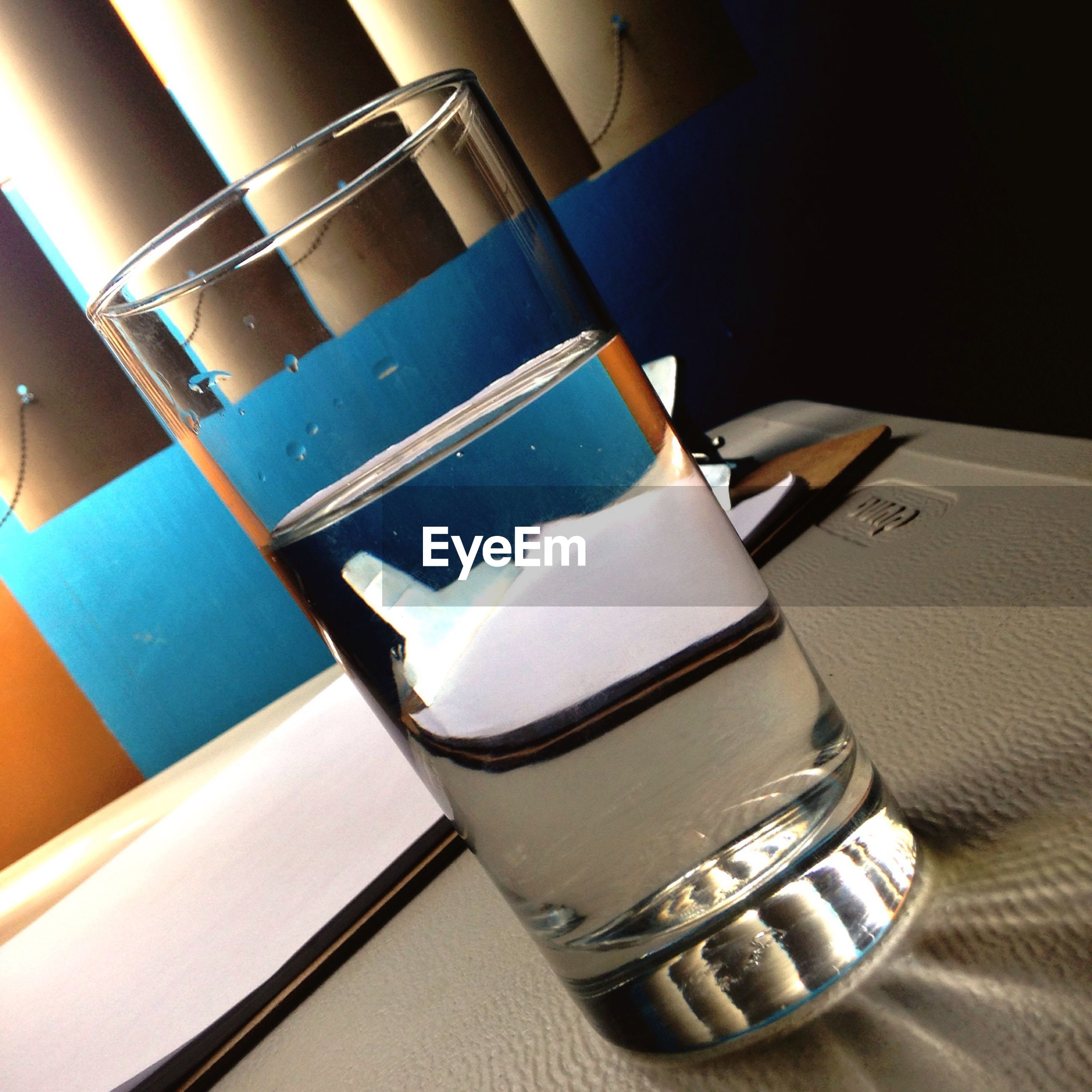 indoors, still life, close-up, table, no people, focus on foreground, absence, white color, metal, blue, empty, day, sunlight, high angle view, chair, drink, reflection, book, part of, single object