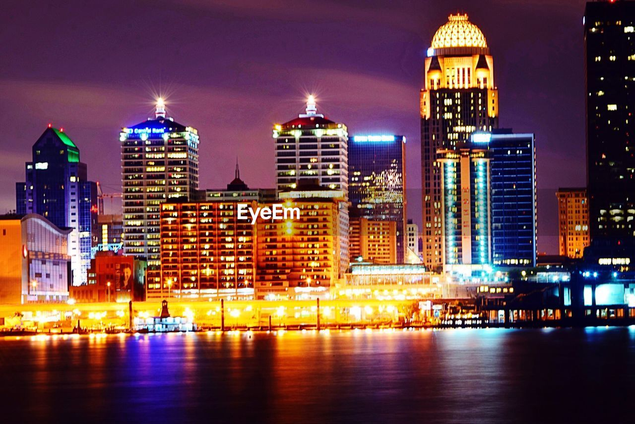 illuminated, architecture, building exterior, night, built structure, city, waterfront, modern, skyscraper, travel destinations, water, river, no people, cityscape, outdoors, sky, urban skyline