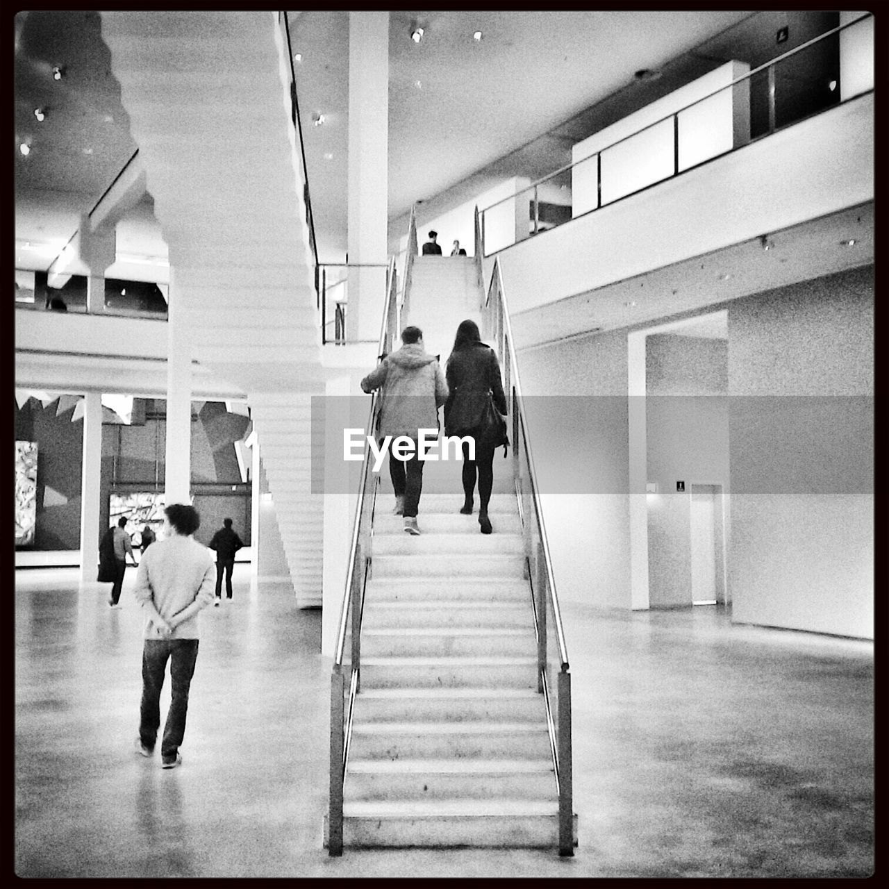 real people, steps, rear view, full length, steps and staircases, indoors, walking, staircase, men, lifestyles, architecture, built structure, standing, women, day, people, adult