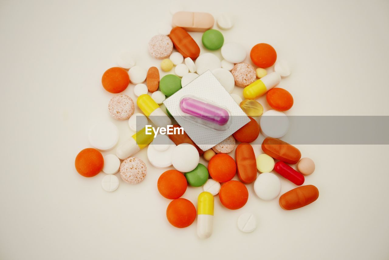 High angle view of tablets against white background