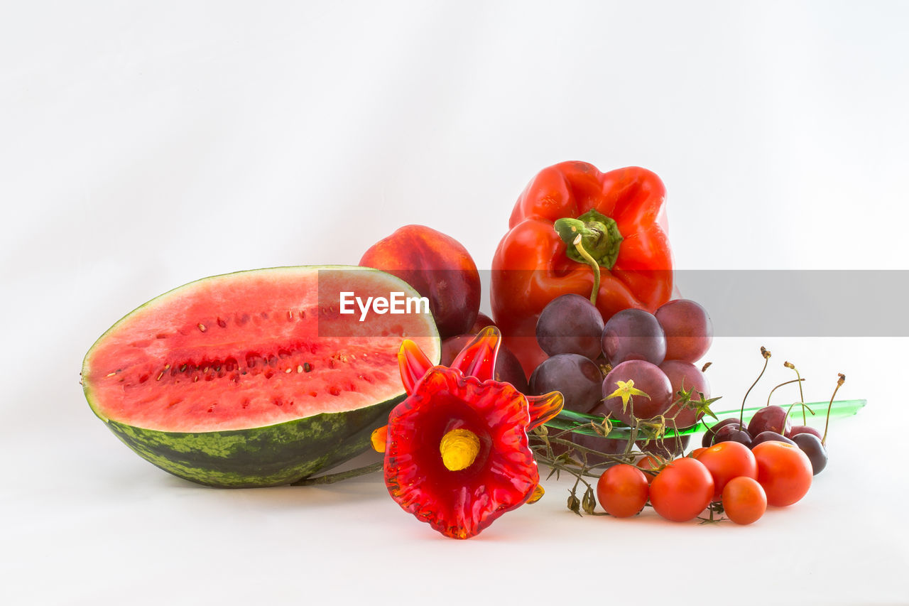 Close-Up Of Fruits With Flowers Against White Background