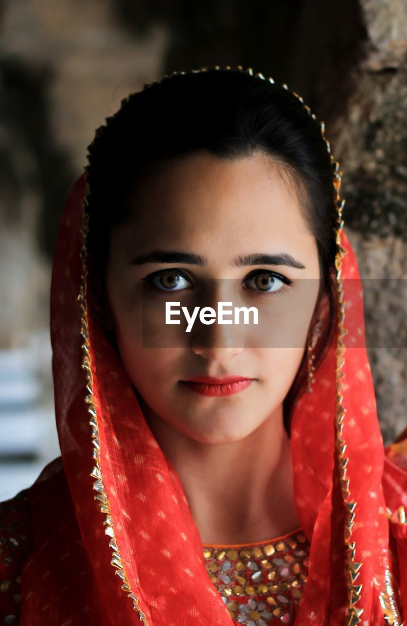 portrait, one person, headshot, young adult, looking at camera, front view, red, young women, beauty, women, real people, lifestyles, beautiful woman, adult, focus on foreground, traditional clothing, make-up, jewelry, leisure activity, hair, lipstick, hairstyle, human face
