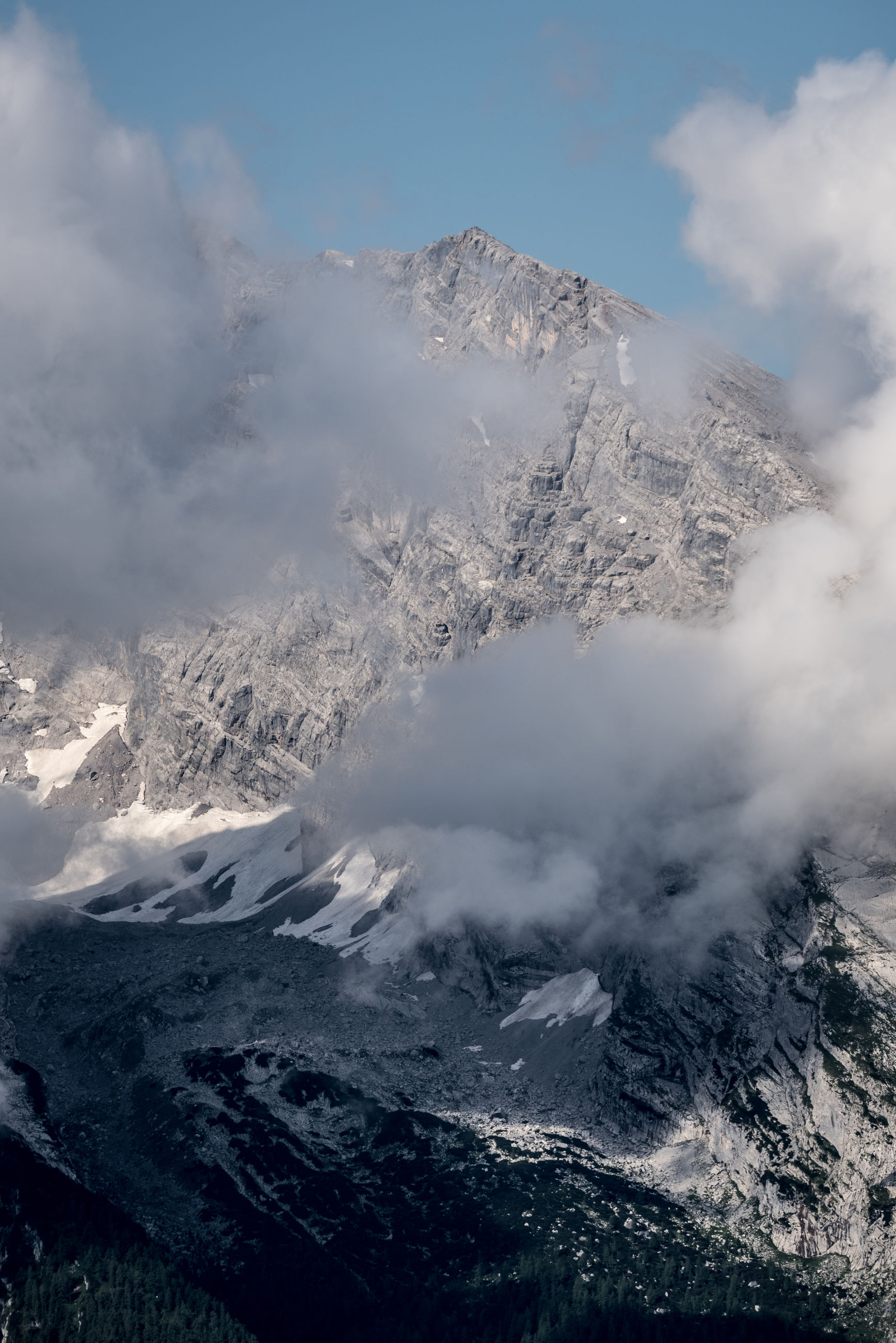 AERIAL VIEW OF SNOW COVERED MOUNTAIN AGAINST SKY