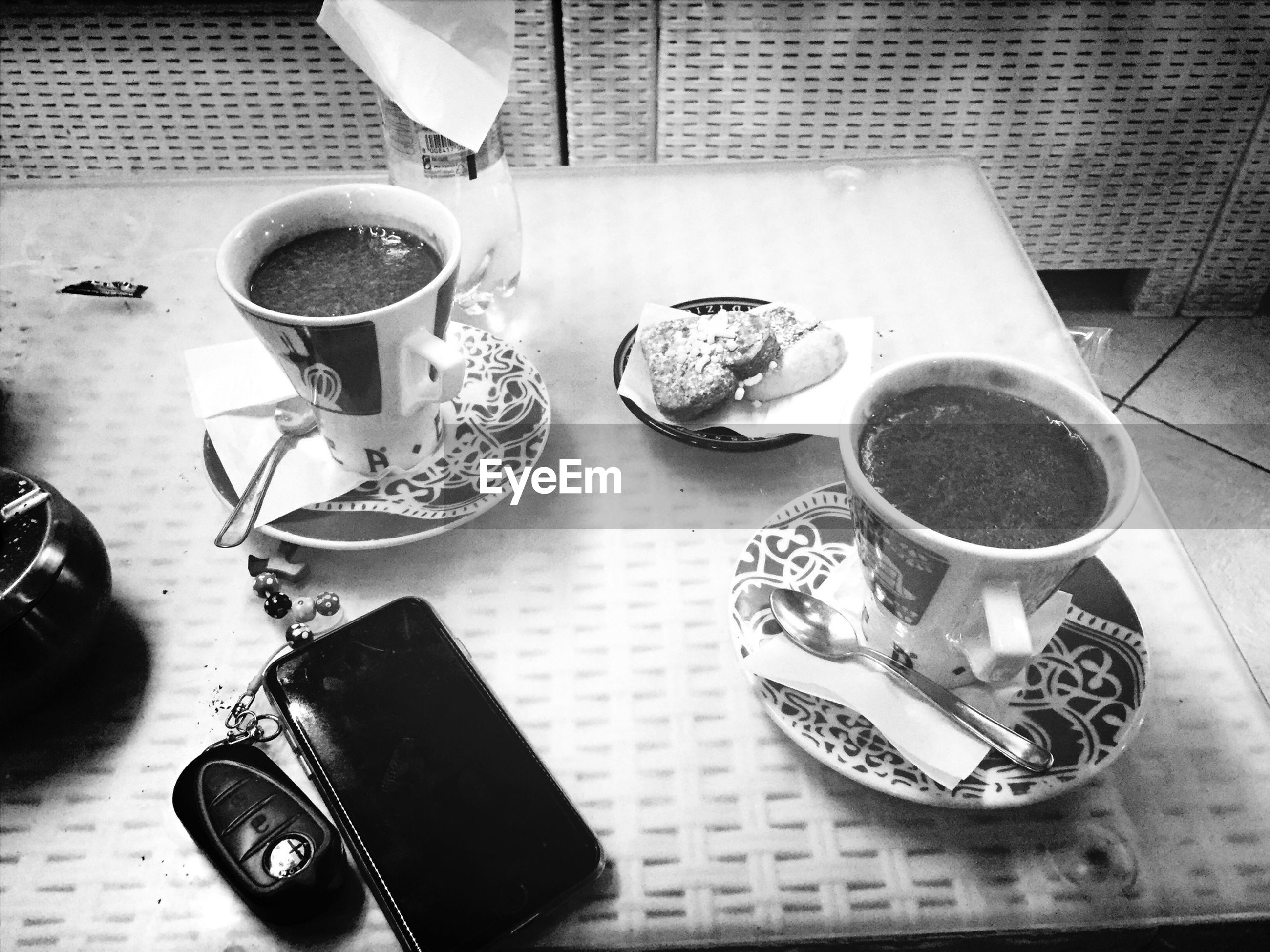 food and drink, drink, table, coffee cup, indoors, coffee - drink, freshness, refreshment, still life, high angle view, spoon, cup, saucer, coffee, food, tea cup, plate, fork, breakfast, directly above