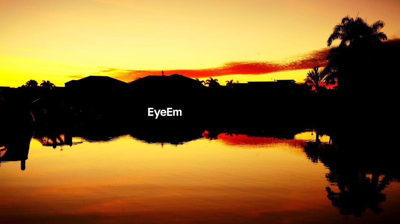 sunset, sky, silhouette, orange color, water, reflection, scenics - nature, beauty in nature, tranquility, tranquil scene, lake, nature, idyllic, tree, plant, non-urban scene, waterfront, cloud - sky, outdoors, romantic sky