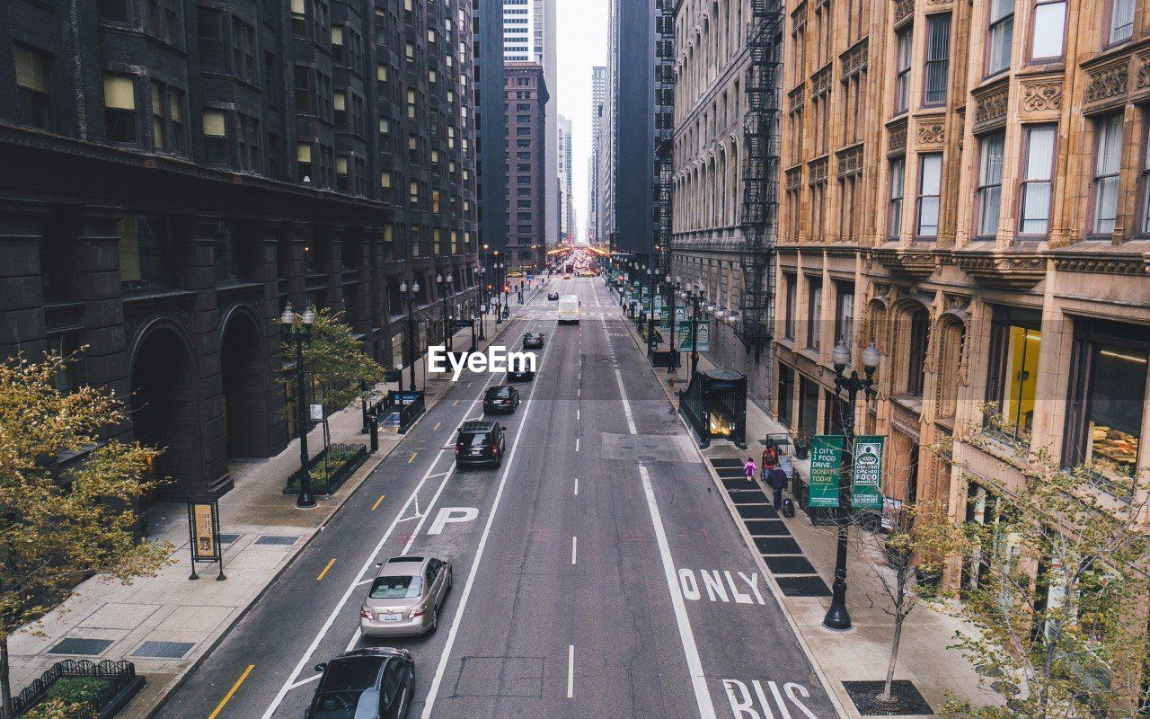 High Angle View Of Cars On Road Amidst Buildings In City