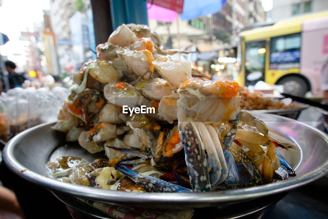 food, food and drink, freshness, incidental people, plate, ready-to-eat, seafood, serving size, healthy eating, close-up, indulgence, cooked, market, day, real people, appetizer, outdoors, one person, fast food, people
