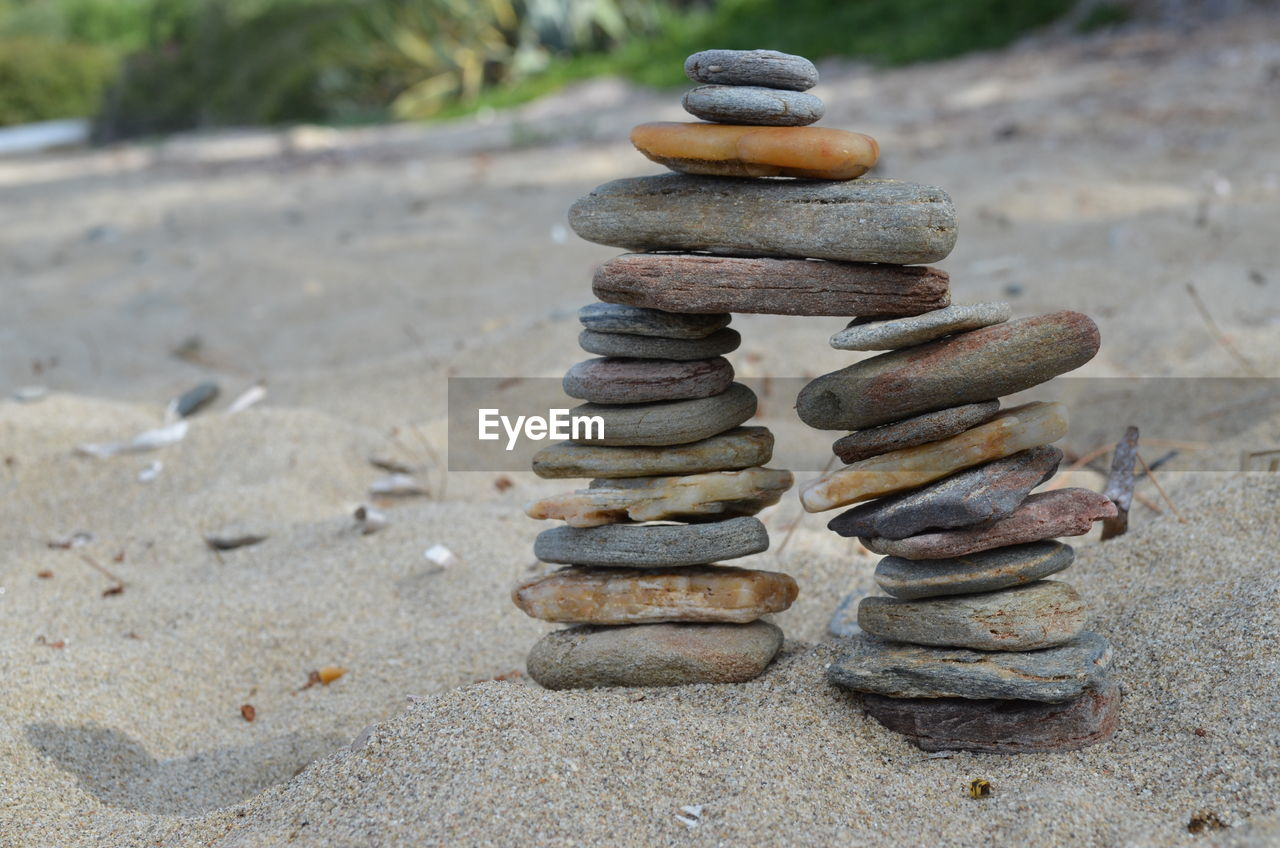 stack, stone - object, balance, focus on foreground, day, solid, no people, close-up, land, rock, nature, zen-like, pebble, outdoors, sunlight, in a row, sand, beach, metal, rock - object