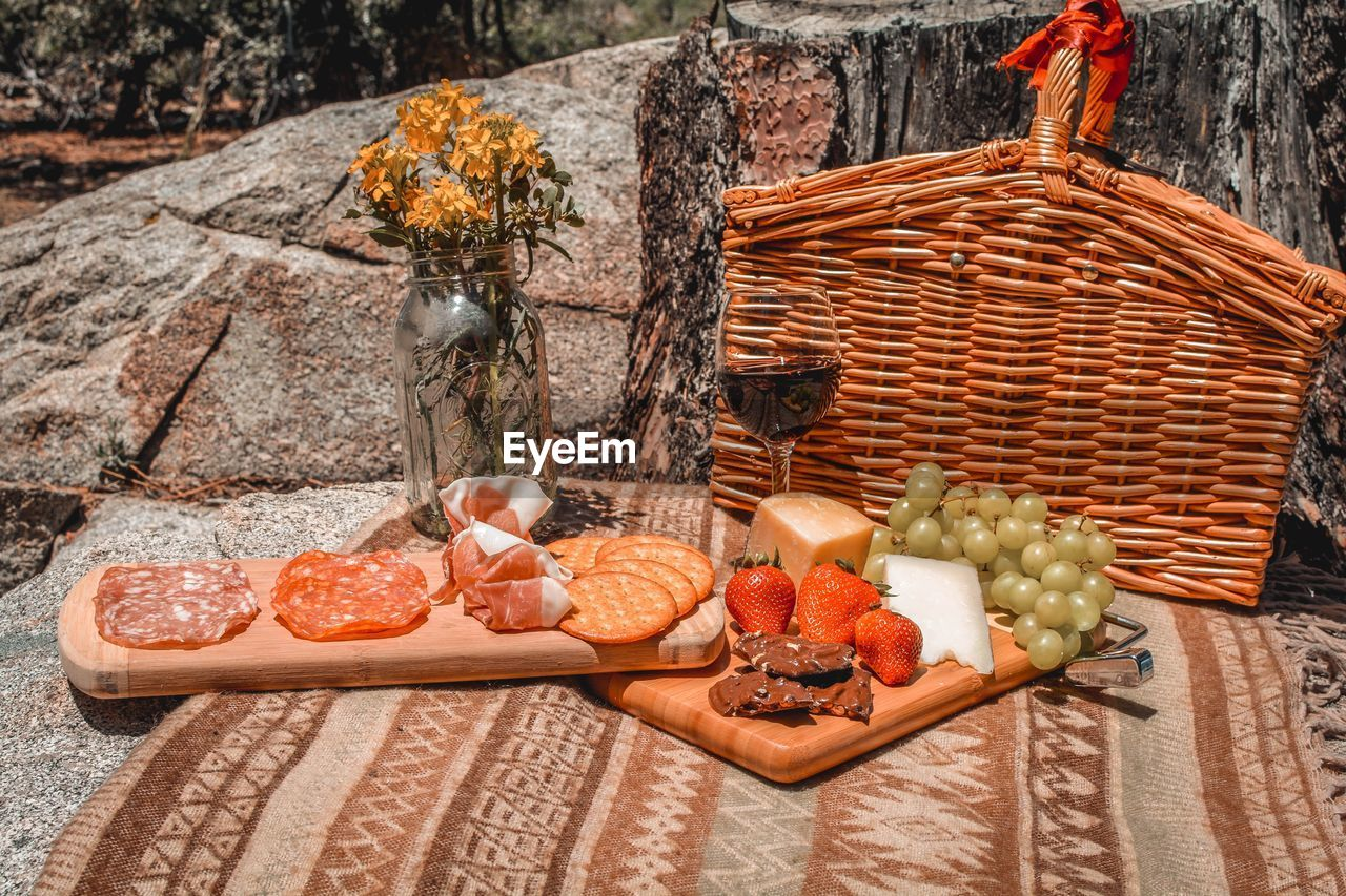 VARIOUS FRUITS AND VEGETABLES ON WOODEN TABLE