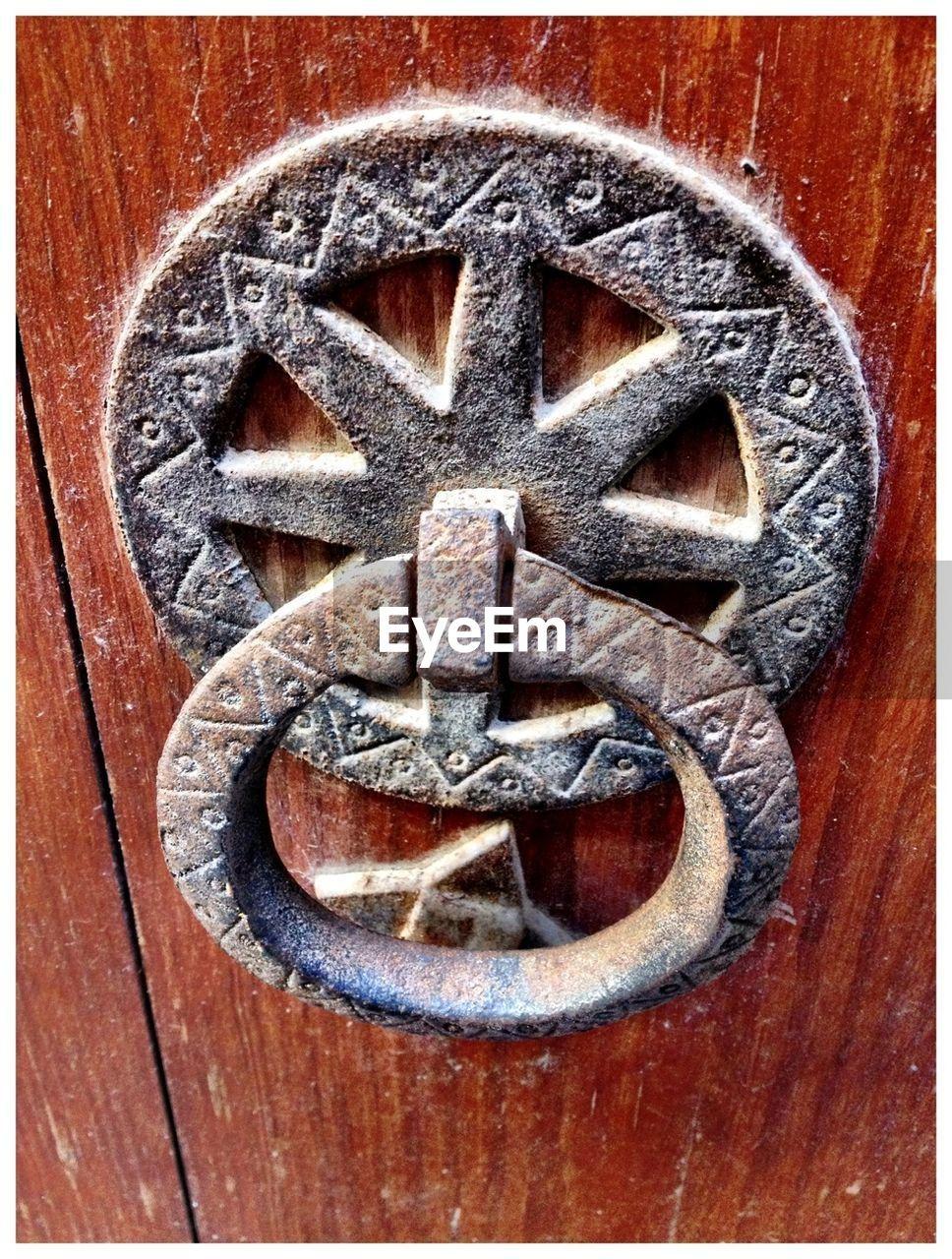 Close-Up View Of Old Door Knocker