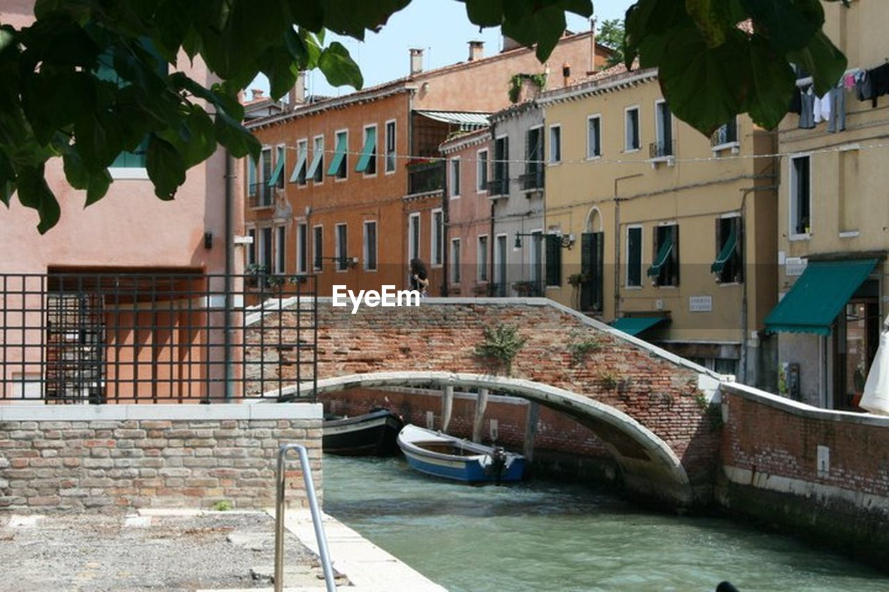 architecture, built structure, building exterior, water, canal, outdoors, day, bridge - man made structure, no people, tree, city
