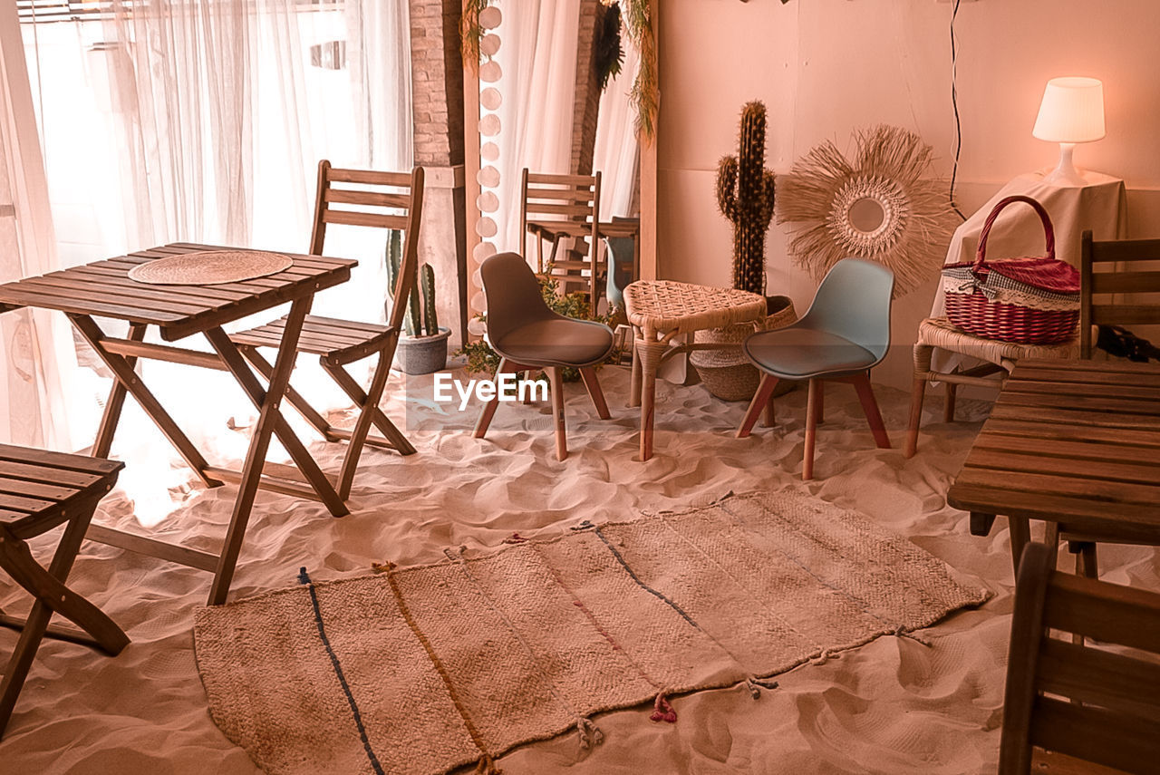 EMPTY CHAIRS AND TABLES AT HOME