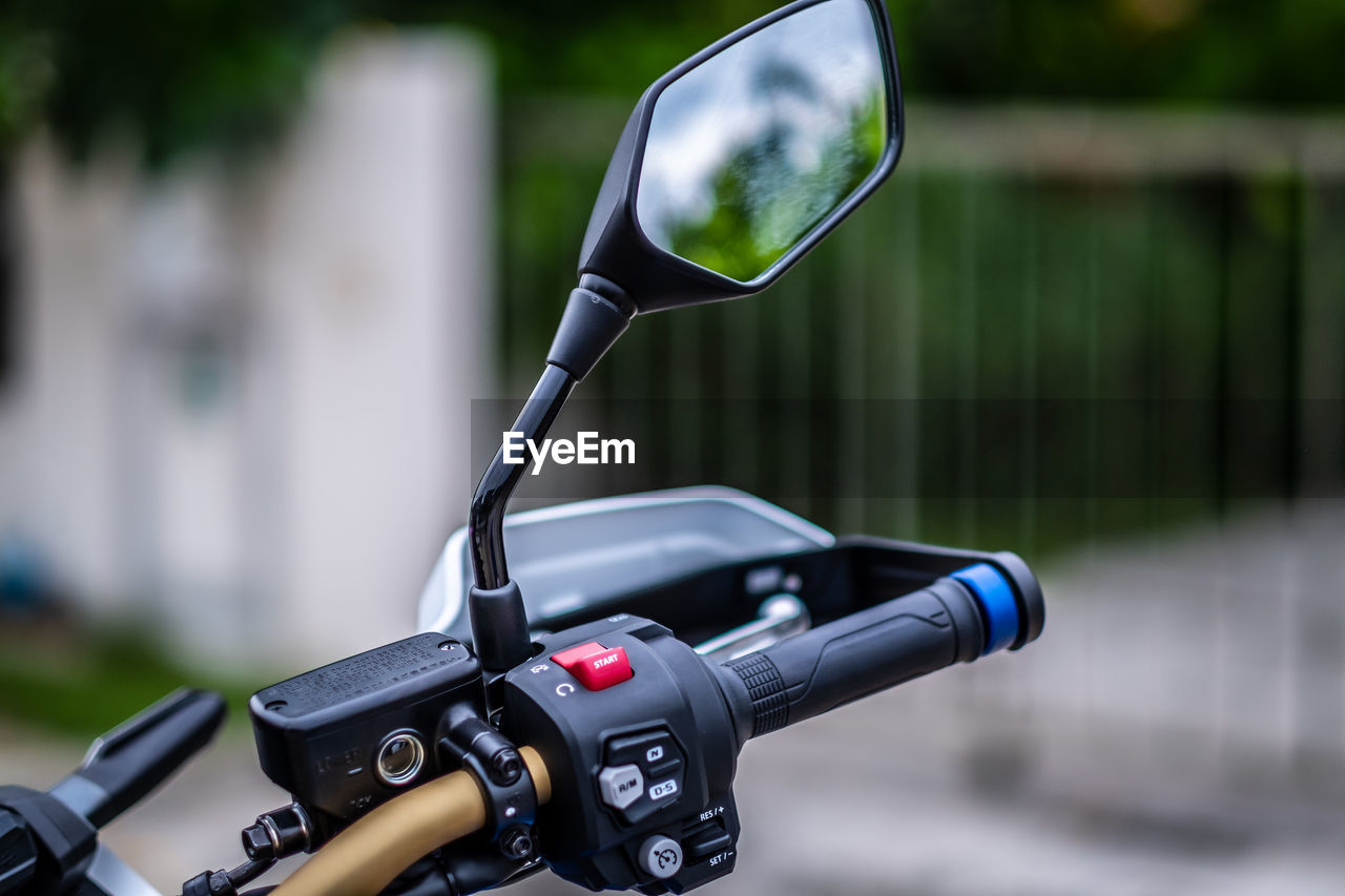 CLOSE-UP OF BICYCLE ON METAL OUTDOORS