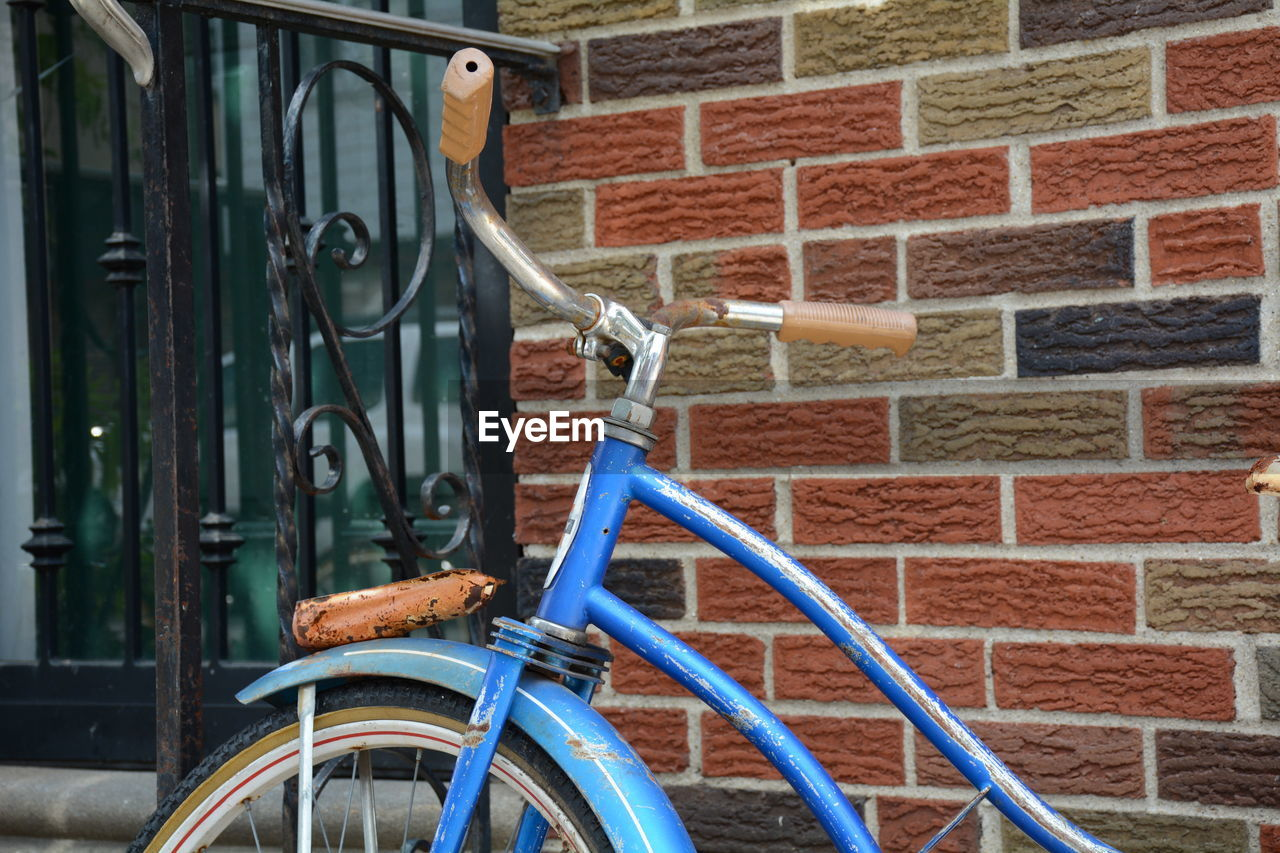 Cropped Image Of Blue Bicycle Against Wall