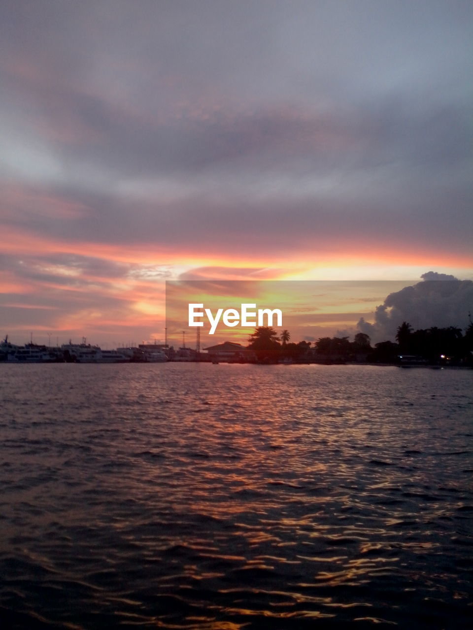 sunset, sky, cloud - sky, no people, nature, beauty in nature, scenics, waterfront, silhouette, water, tranquility, tranquil scene, outdoors, architecture, day