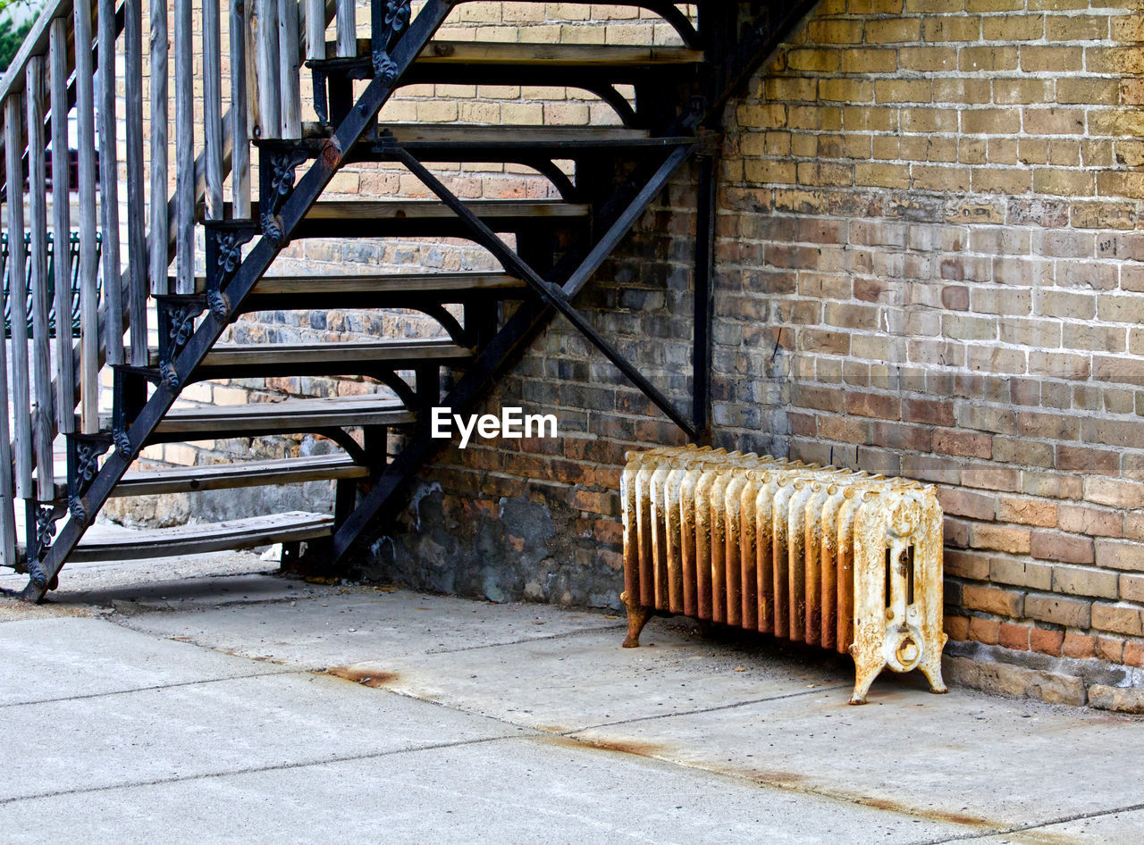 STAIRCASE ON SIDEWALK AGAINST WALL