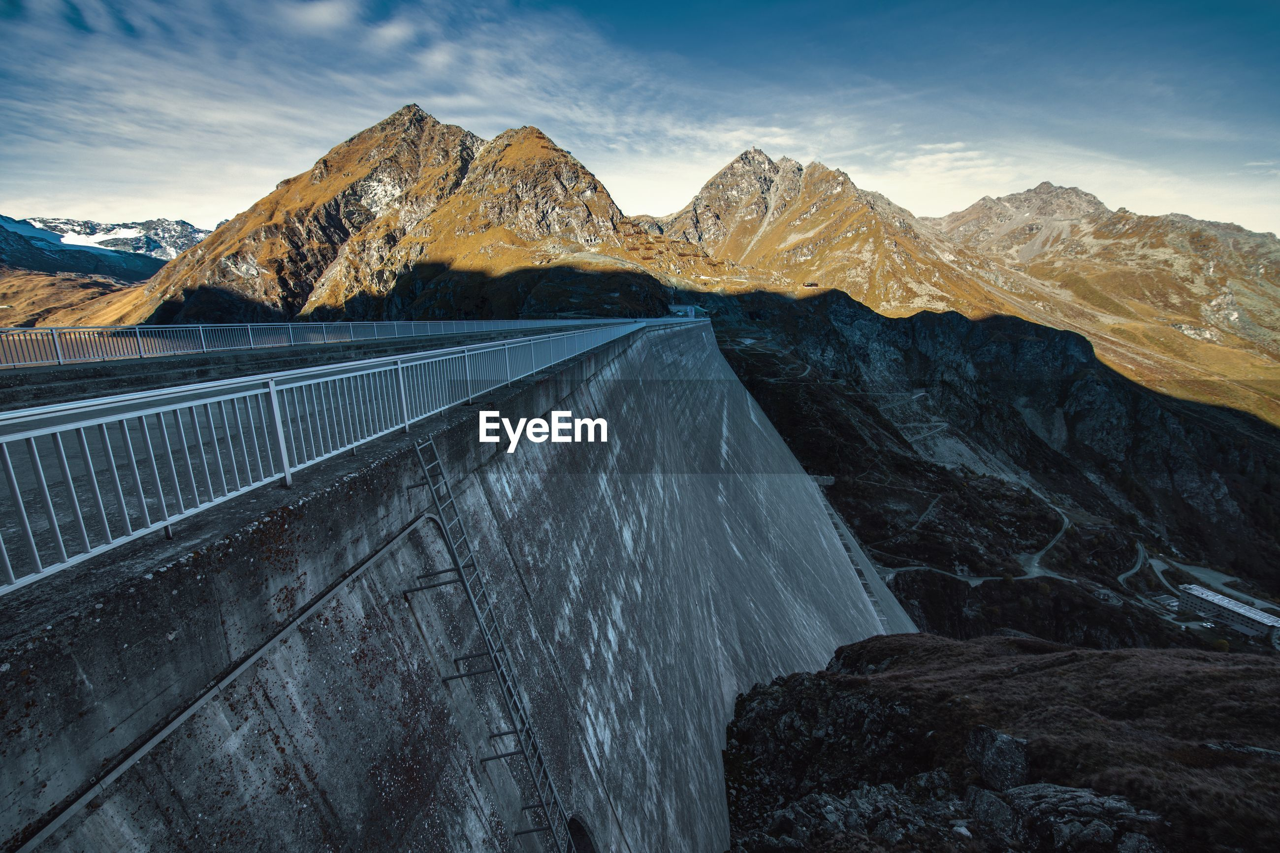 View of dam and mountains against sky