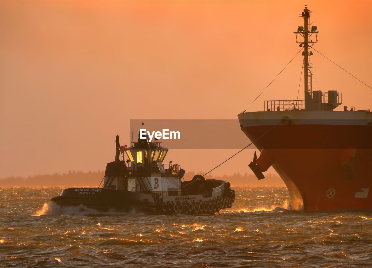 nautical vessel, sea, transportation, sunset, orange color, ship, freight transportation, container ship, mode of transport, waterfront, water, industrial ship, shipping, sailing, industry, no people, outdoors, sky, nature, navy, cargo container, offshore platform, military, day, sailing ship, drilling rig, oil pump