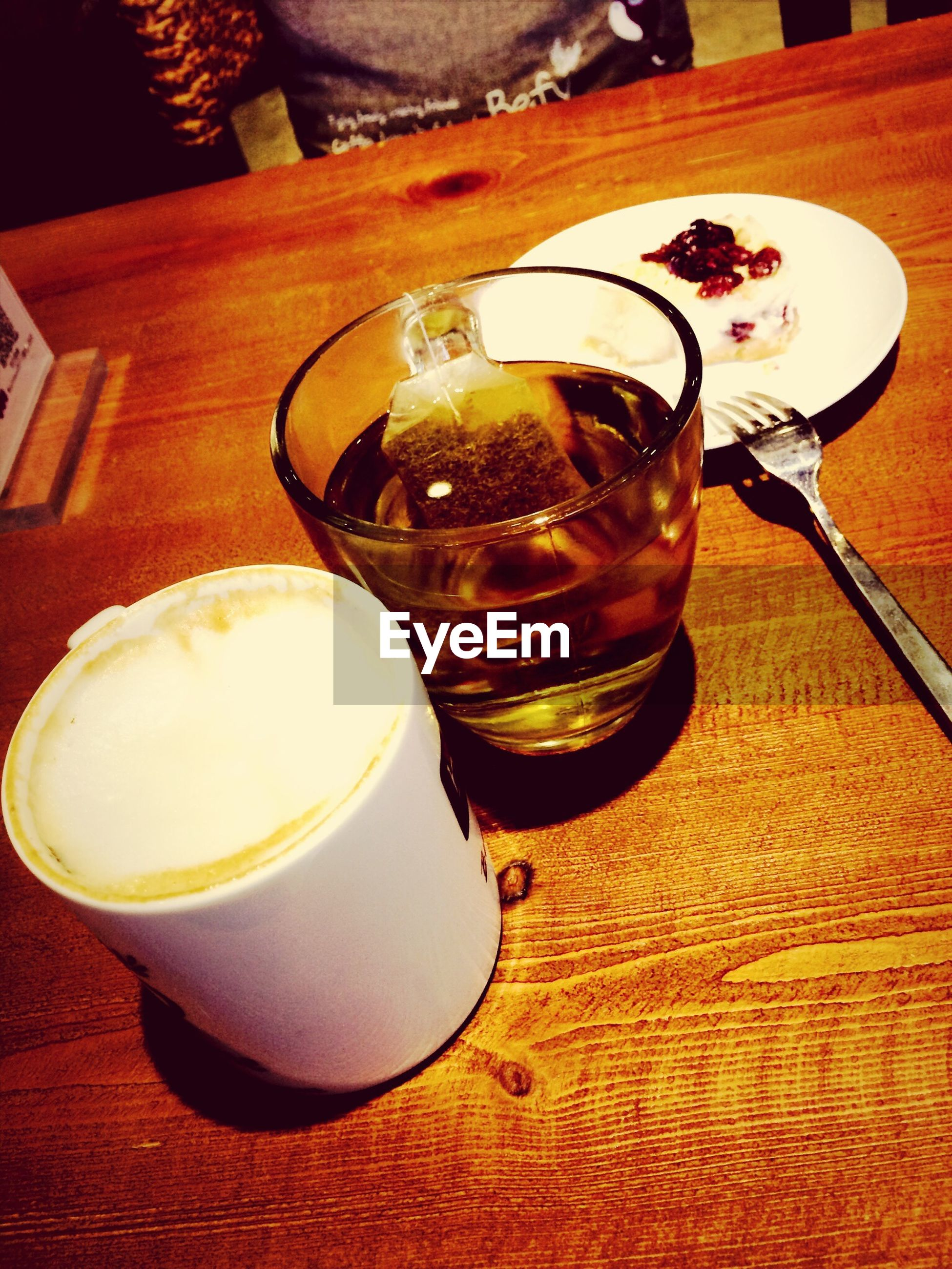 drink, food and drink, table, refreshment, indoors, freshness, still life, coffee cup, coffee - drink, drinking glass, wood - material, high angle view, frothy drink, close-up, saucer, coffee, wooden, spoon, no people, beverage