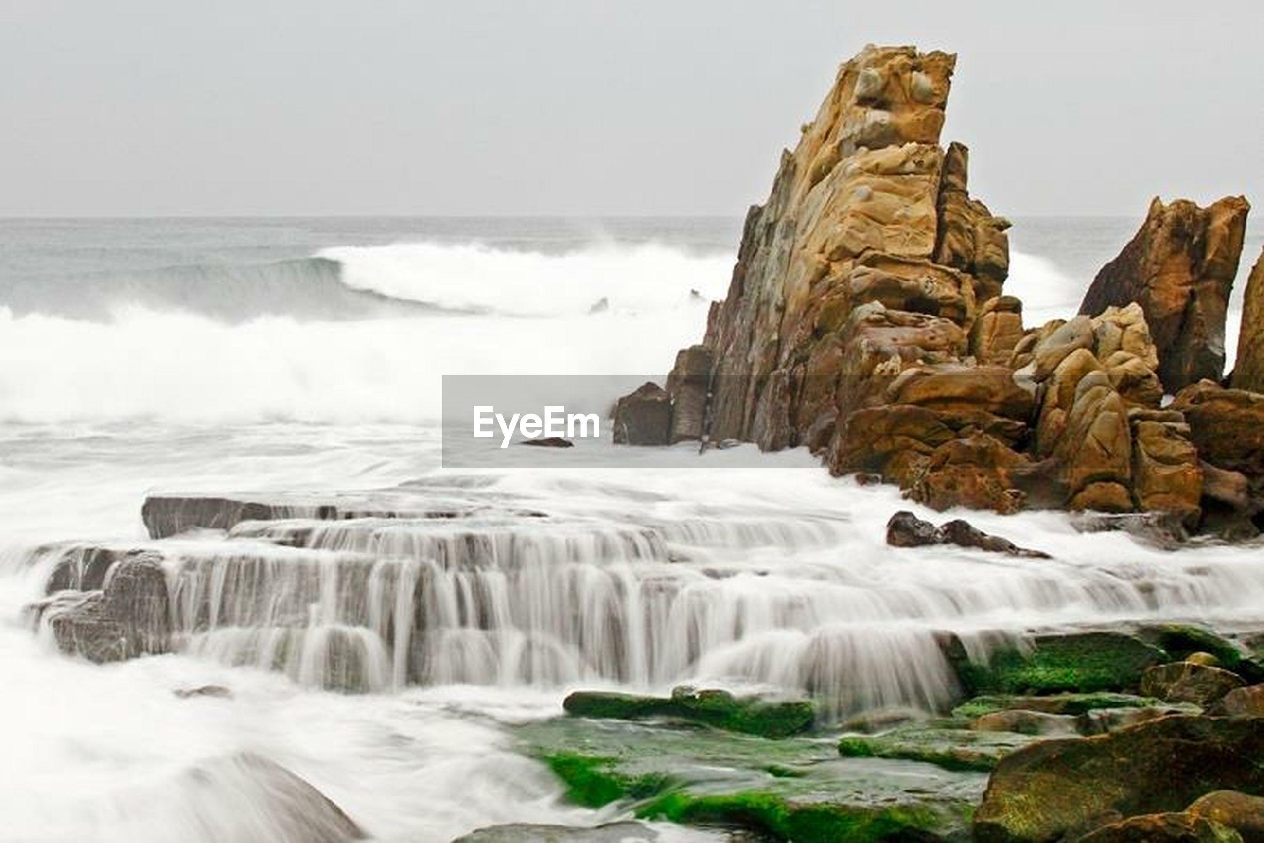 water, motion, surf, sea, splashing, rock - object, wave, scenics, beauty in nature, long exposure, power in nature, rock formation, waterfall, nature, flowing water, horizon over water, rock, idyllic, flowing, sky