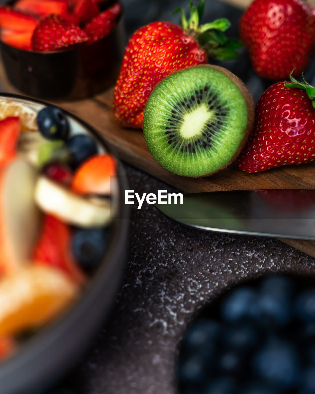 High angle view of chopped fresh fruits in bowl on table
