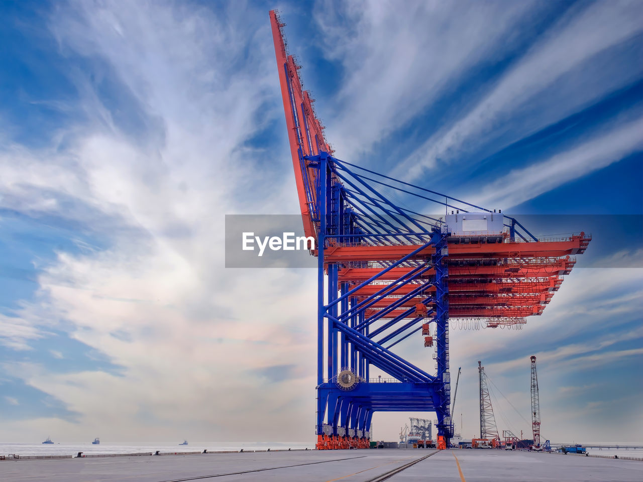 cloud - sky, sky, crane - construction machinery, built structure, architecture, transportation, no people, outdoors, freight transportation, industry, commercial dock, red, day, building exterior, nature, beauty in nature, shipyard