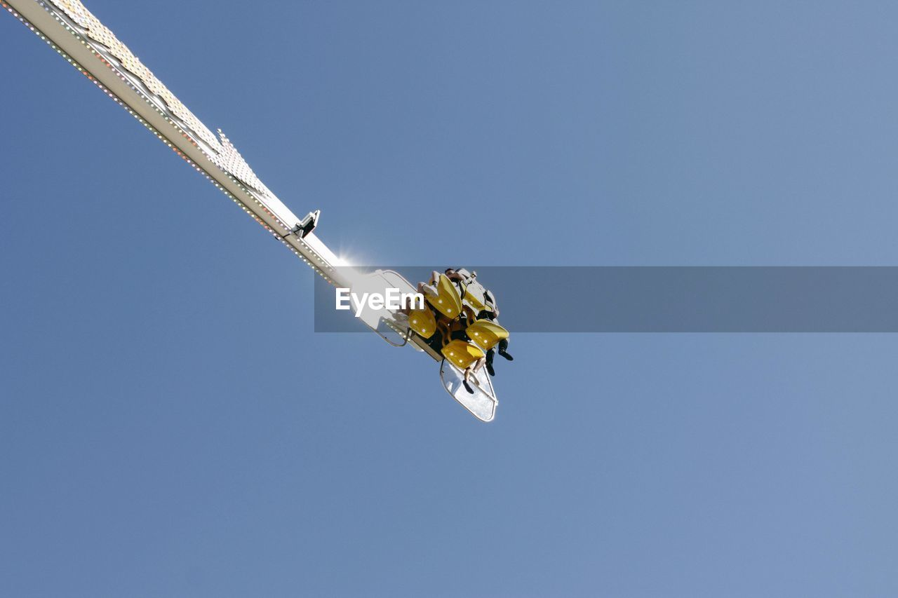 low angle view, clear sky, blue, day, flying, no people, outdoors, sky