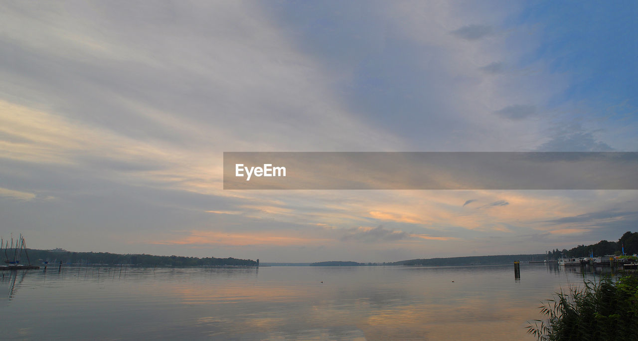 water, sky, scenics, beauty in nature, sunset, cloud - sky, nature, tranquil scene, tranquility, sea, waterfront, outdoors, no people, architecture, day