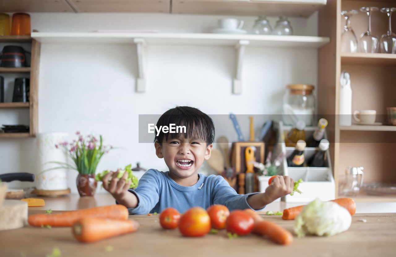 Portrait Of Boy In Kitchen At Home