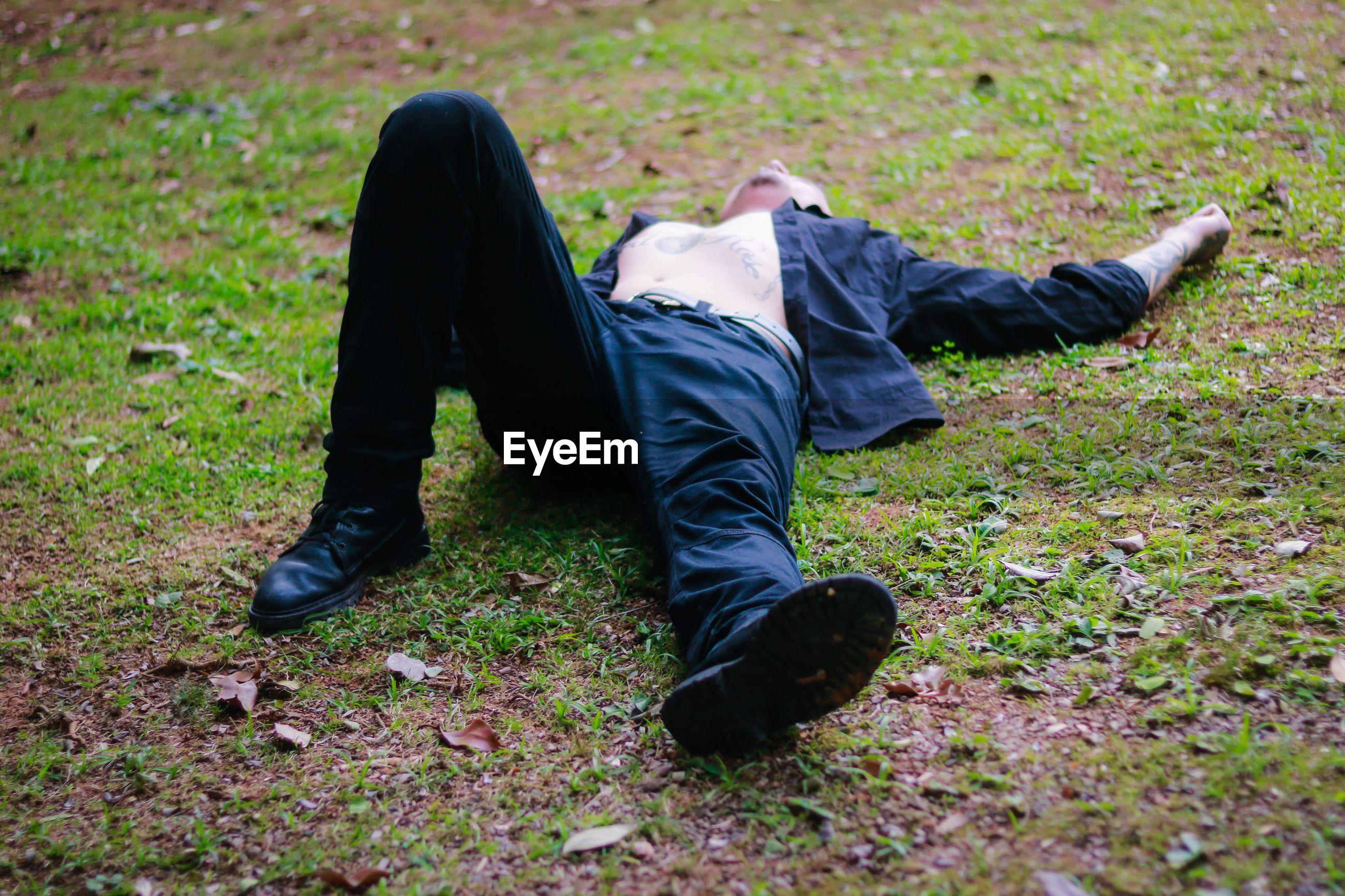 Man lying down on field