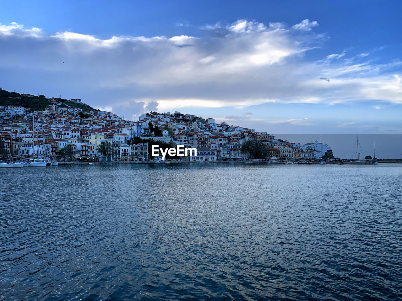 water, architecture, built structure, building exterior, sky, waterfront, city, cloud - sky, building, sea, no people, nature, beauty in nature, scenics - nature, day, residential district, town, outdoors, rippled, townscape