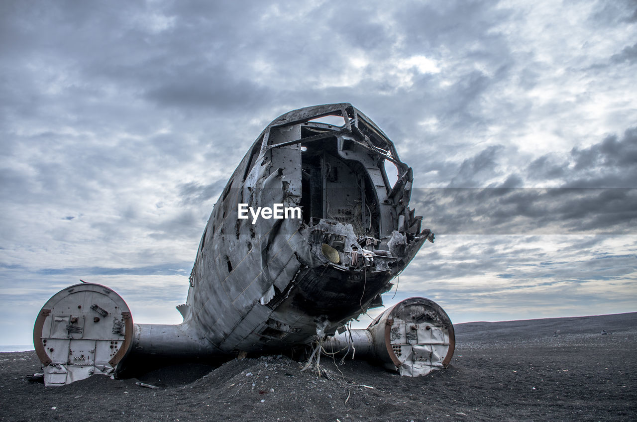 Abandoned Airplane On Black Sand