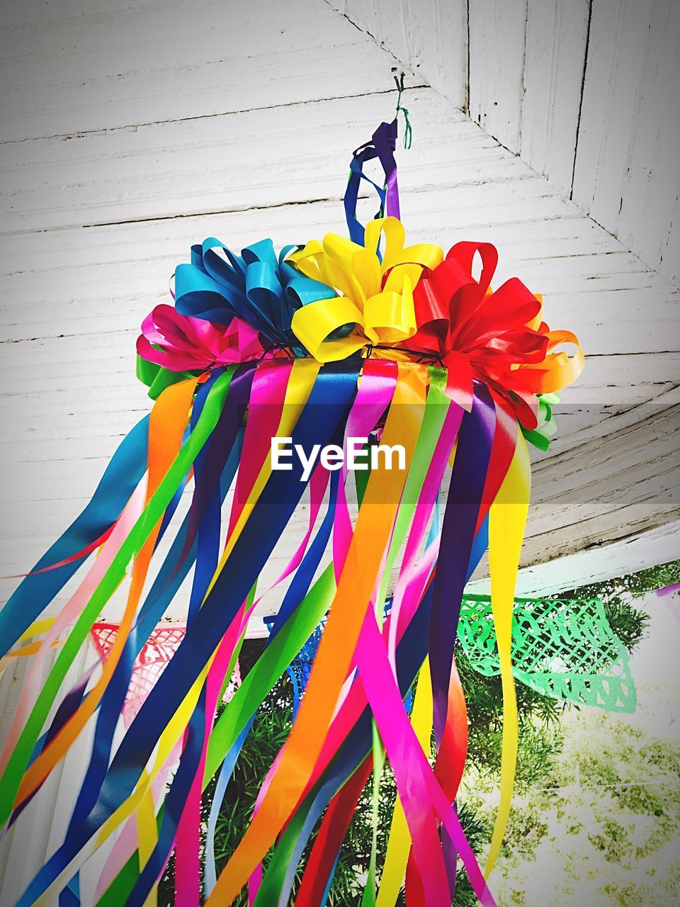 Low Angle View Of Multi Colored Ribbons Hanging On Umbrella