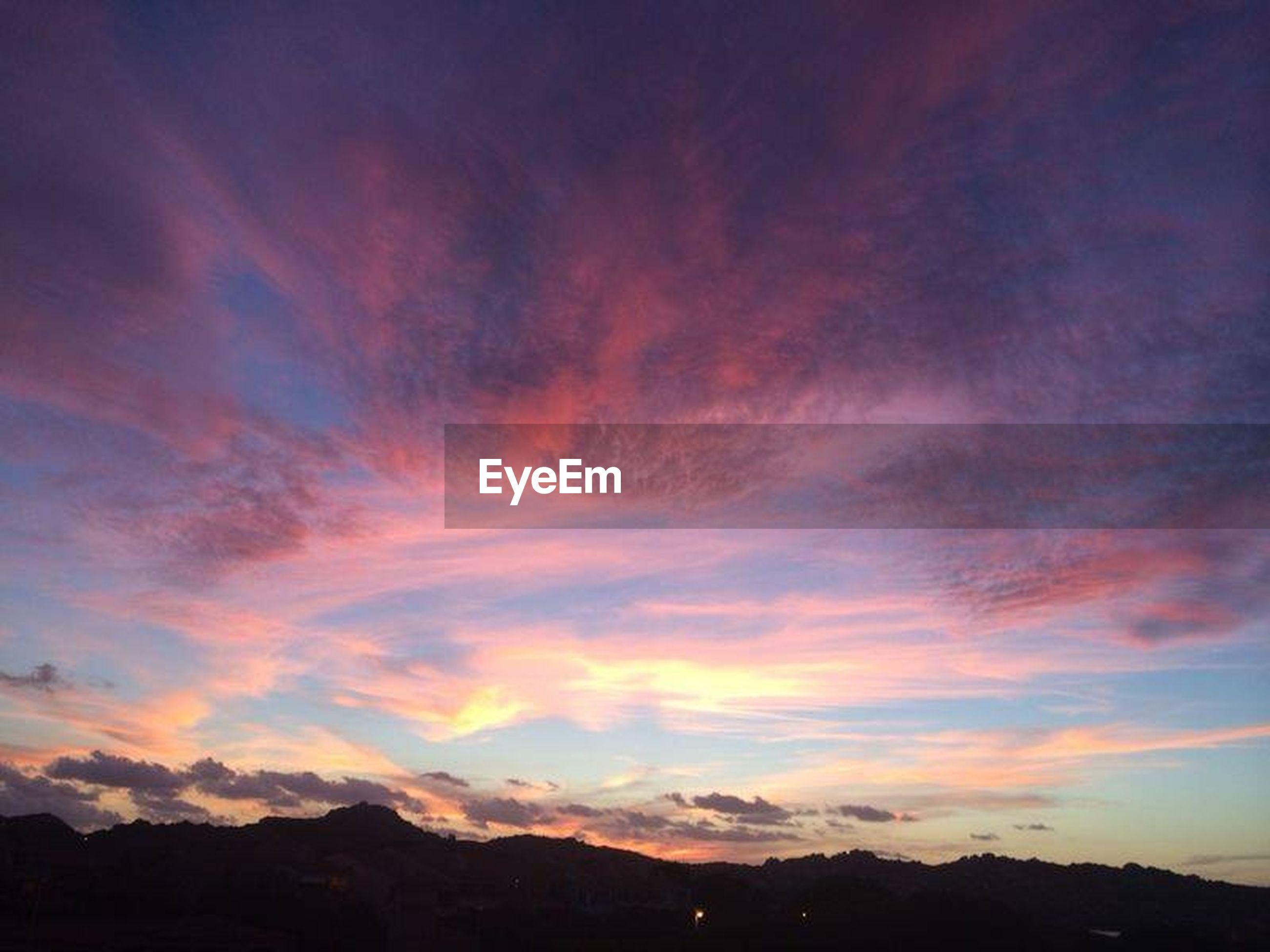scenics, sky, sunset, tranquil scene, mountain, beauty in nature, tranquility, cloud - sky, silhouette, nature, landscape, mountain range, idyllic, orange color, dramatic sky, cloud, cloudy, majestic, non-urban scene, dusk