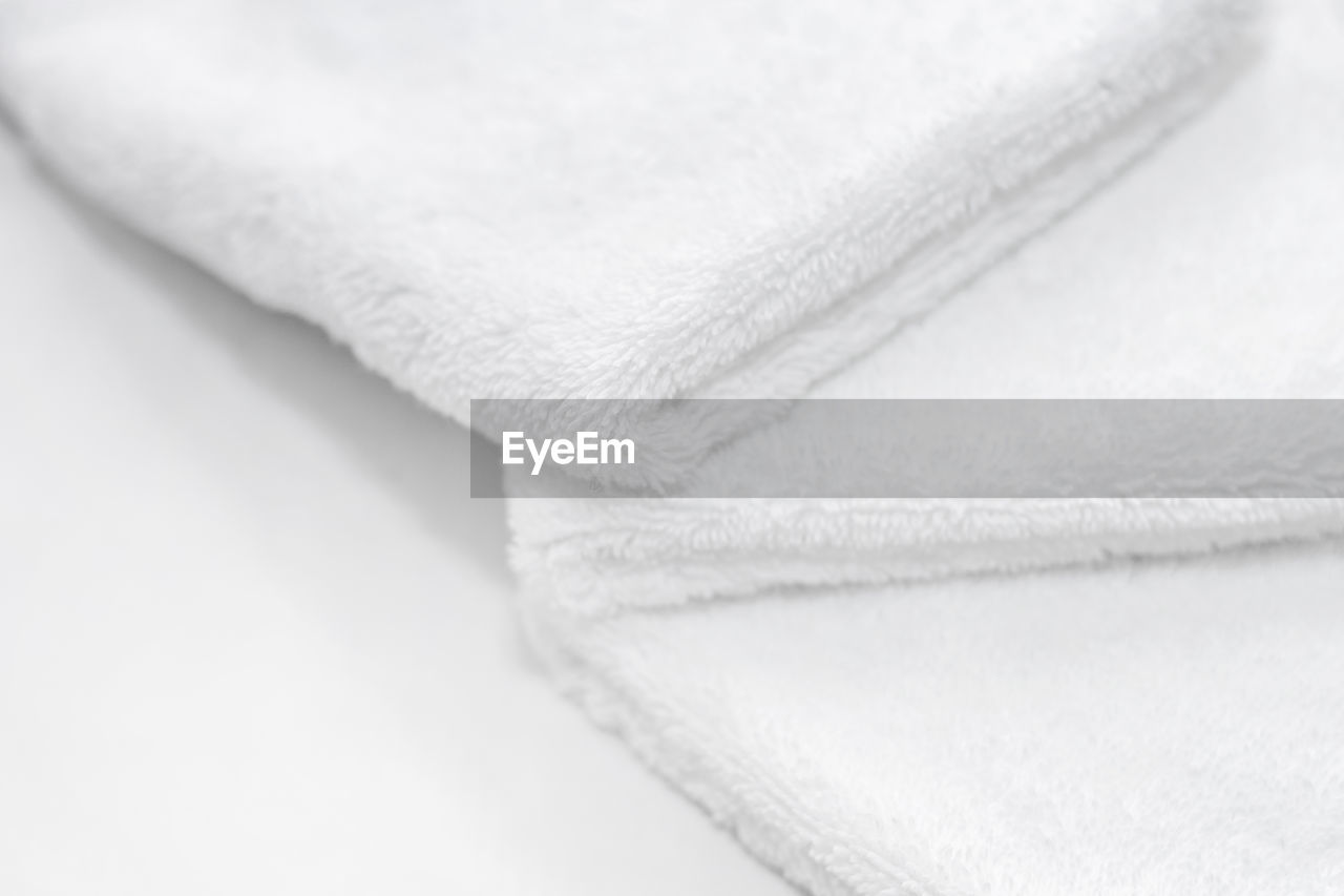 Close-up of towels against white background