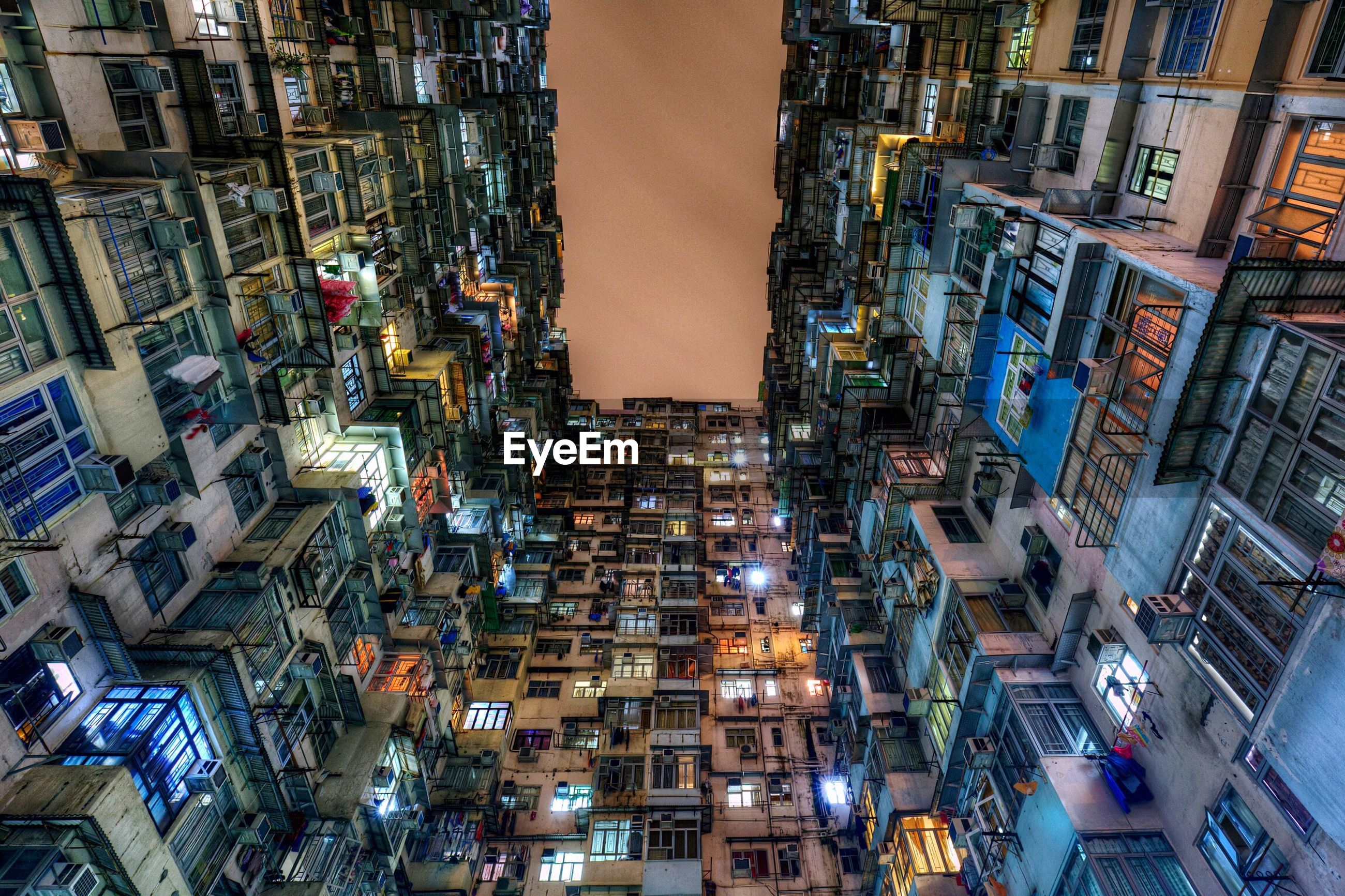 Low angle view of montane mansiona at quarry bay in city during night