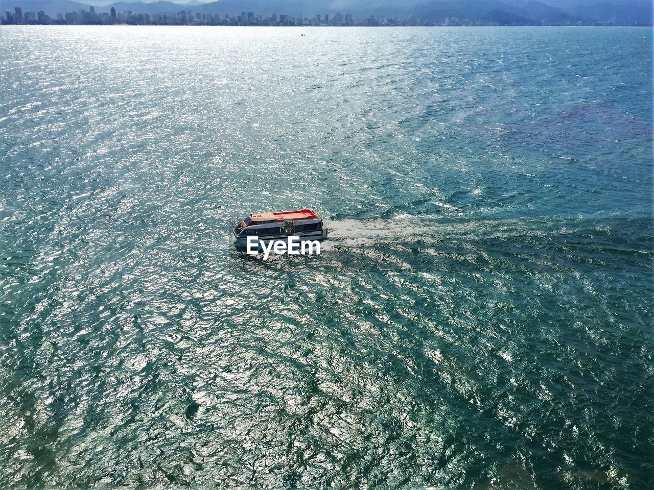 water, sea, waterfront, mode of transportation, nautical vessel, transportation, wave pattern, high angle view, day, motion, wake - water, scenics - nature, nature, beauty in nature, sport, travel, wake, outdoors, sailing, inflatable