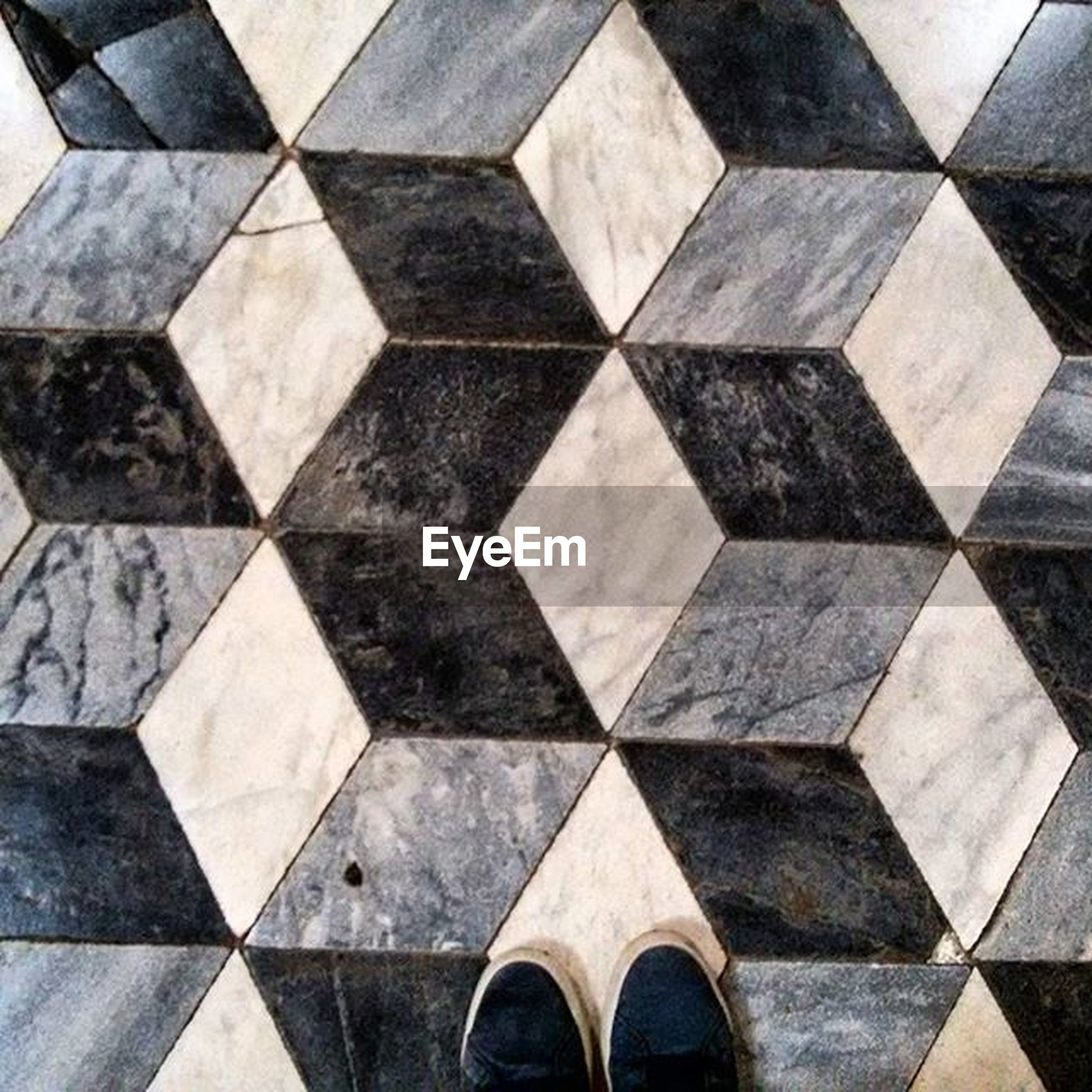 pattern, tiled floor, flooring, high angle view, cobblestone, full frame, paving stone, indoors, backgrounds, tile, design, geometric shape, repetition, pavement, directly above, floor, in a row, textured, shape, footpath