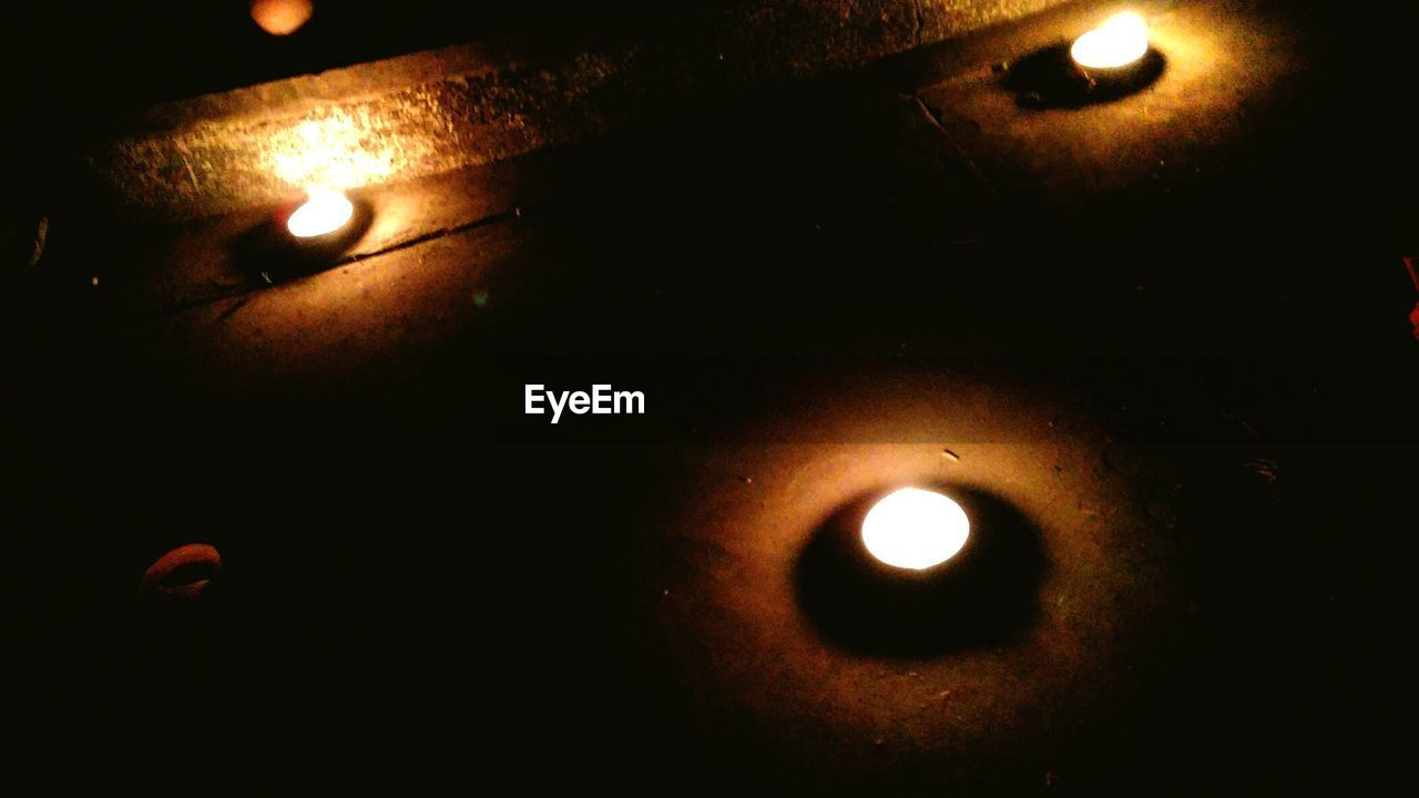 High Angle View Of Oil Lamps On Sidewalk