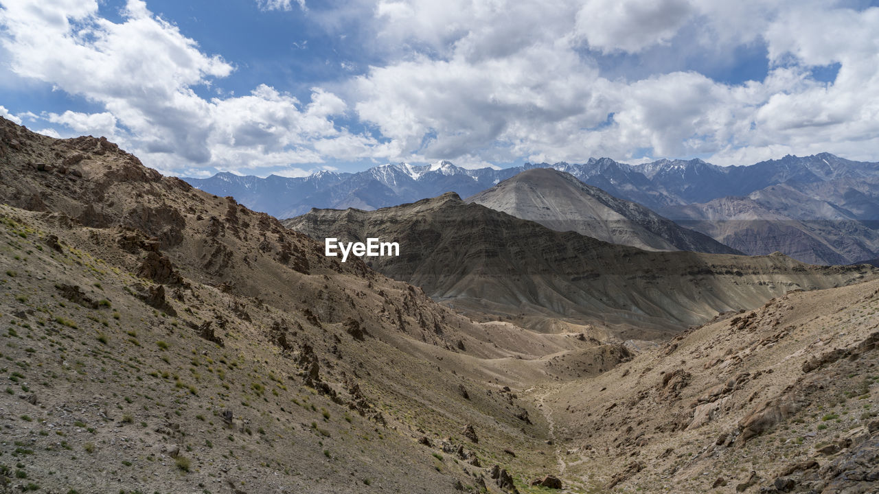 mountain, sky, environment, landscape, cloud - sky, scenics - nature, beauty in nature, mountain range, tranquil scene, non-urban scene, nature, tranquility, no people, day, land, physical geography, outdoors, geology, remote, idyllic, formation, mountain peak, arid climate, range