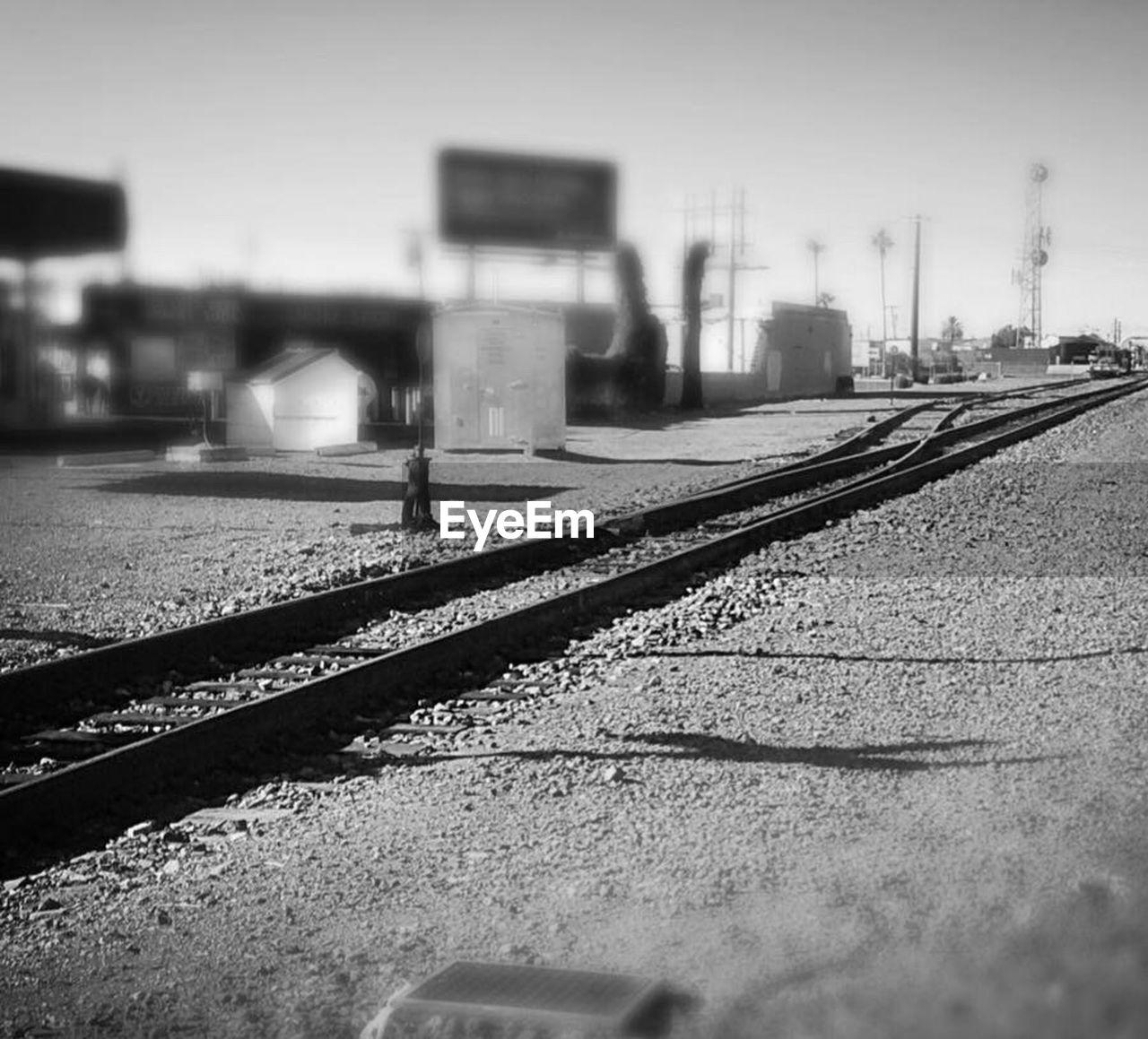 railroad track, transportation, rail transportation, public transportation, architecture, built structure, mode of transport, no people, outdoors, day, building exterior, sky, city, close-up