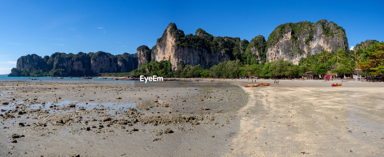 water, sky, mountain, beach, land, sea, scenics - nature, nature, sand, rock, beauty in nature, day, blue, rock formation, clear sky, tranquility, incidental people, tranquil scene, rock - object, outdoors, formation