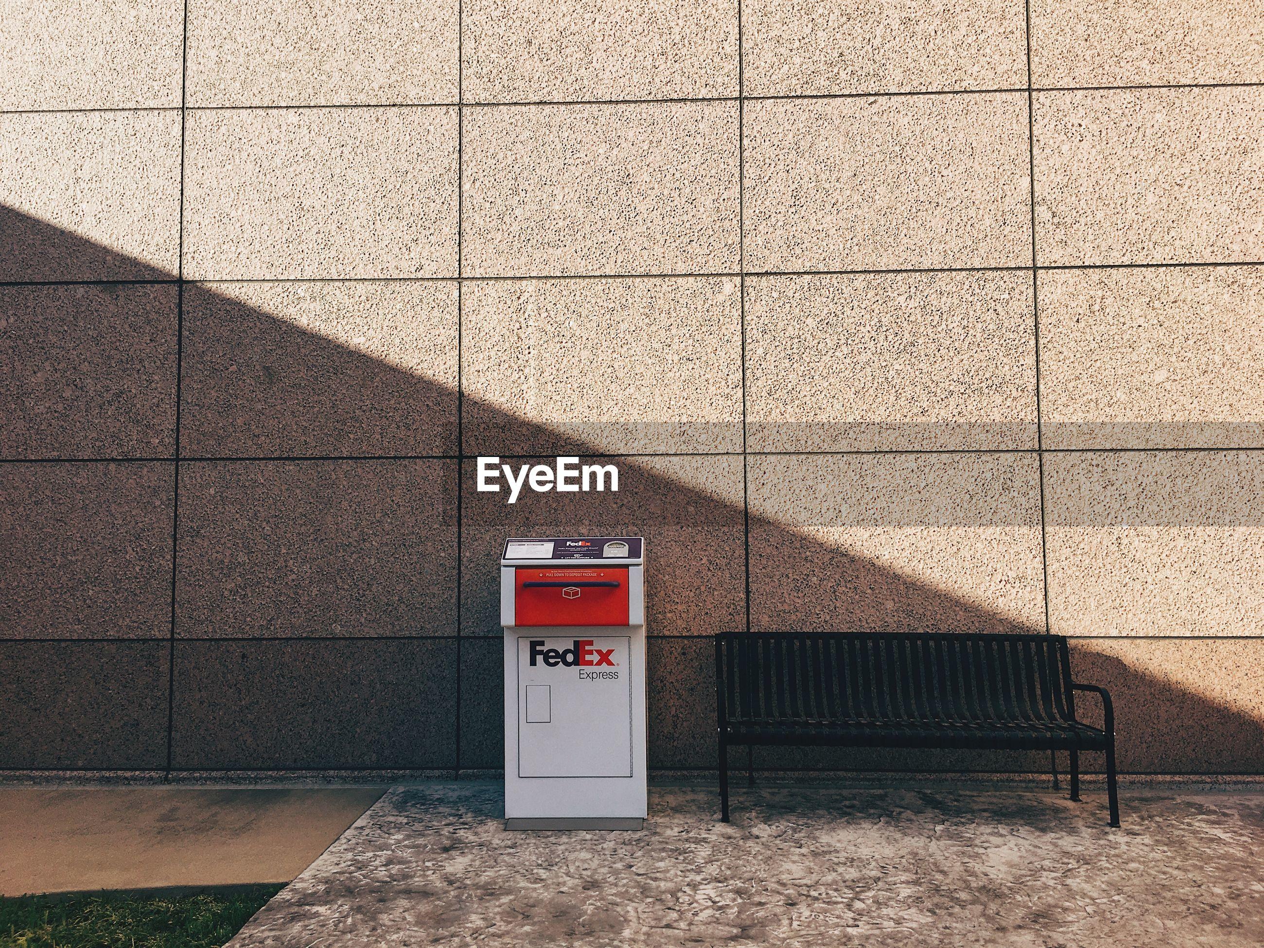 ARROW SIGN ON WALL