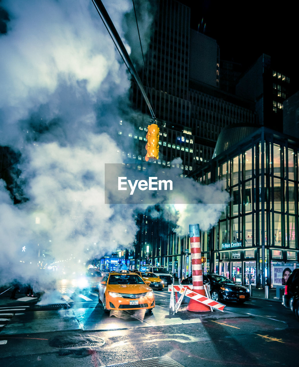 transportation, illuminated, mode of transportation, car, architecture, built structure, land vehicle, city, motion, building exterior, motor vehicle, night, street, road, smoke - physical structure, outdoors, nature, blurred motion, travel, no people, air pollution